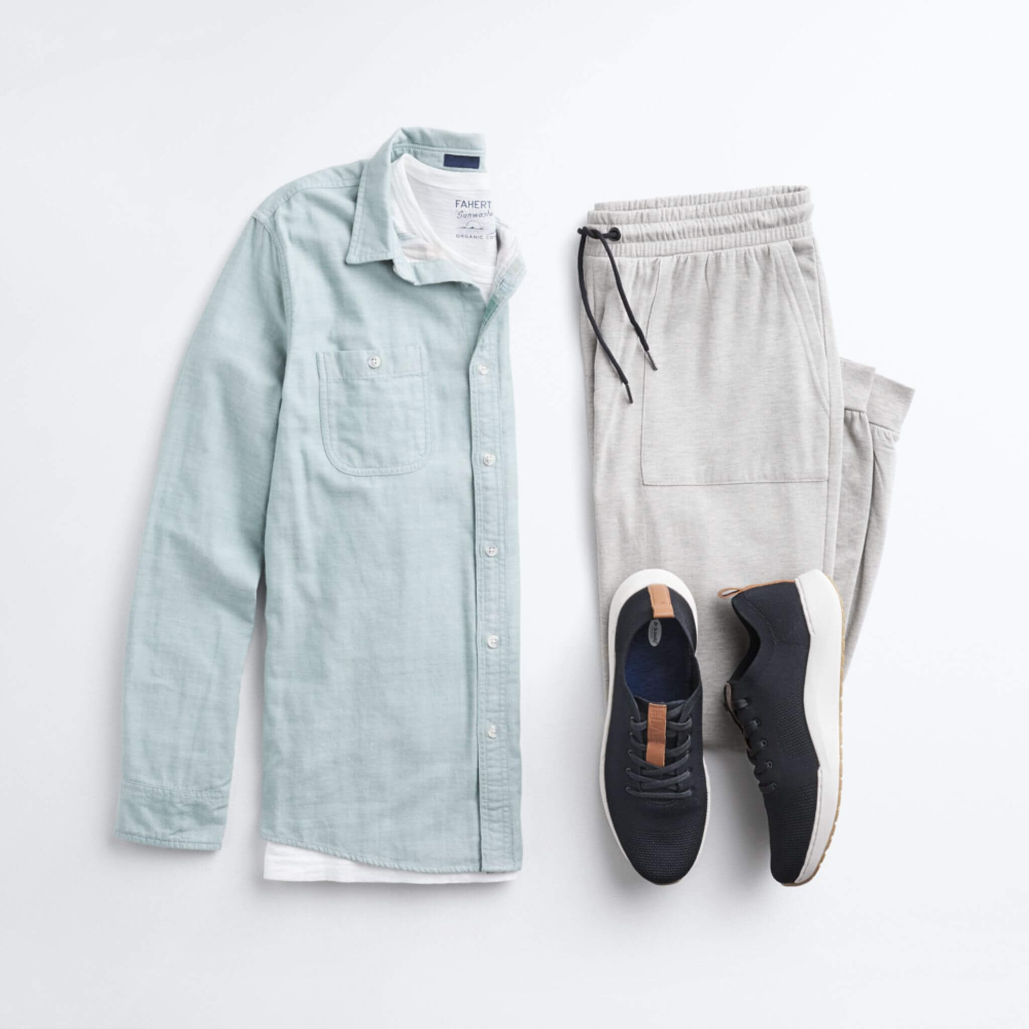 Stitch Fix Men's outfit laydown featuring a light green button-down shirt over a white crewneck t-shirt, next to grey joggers and black sneakers.