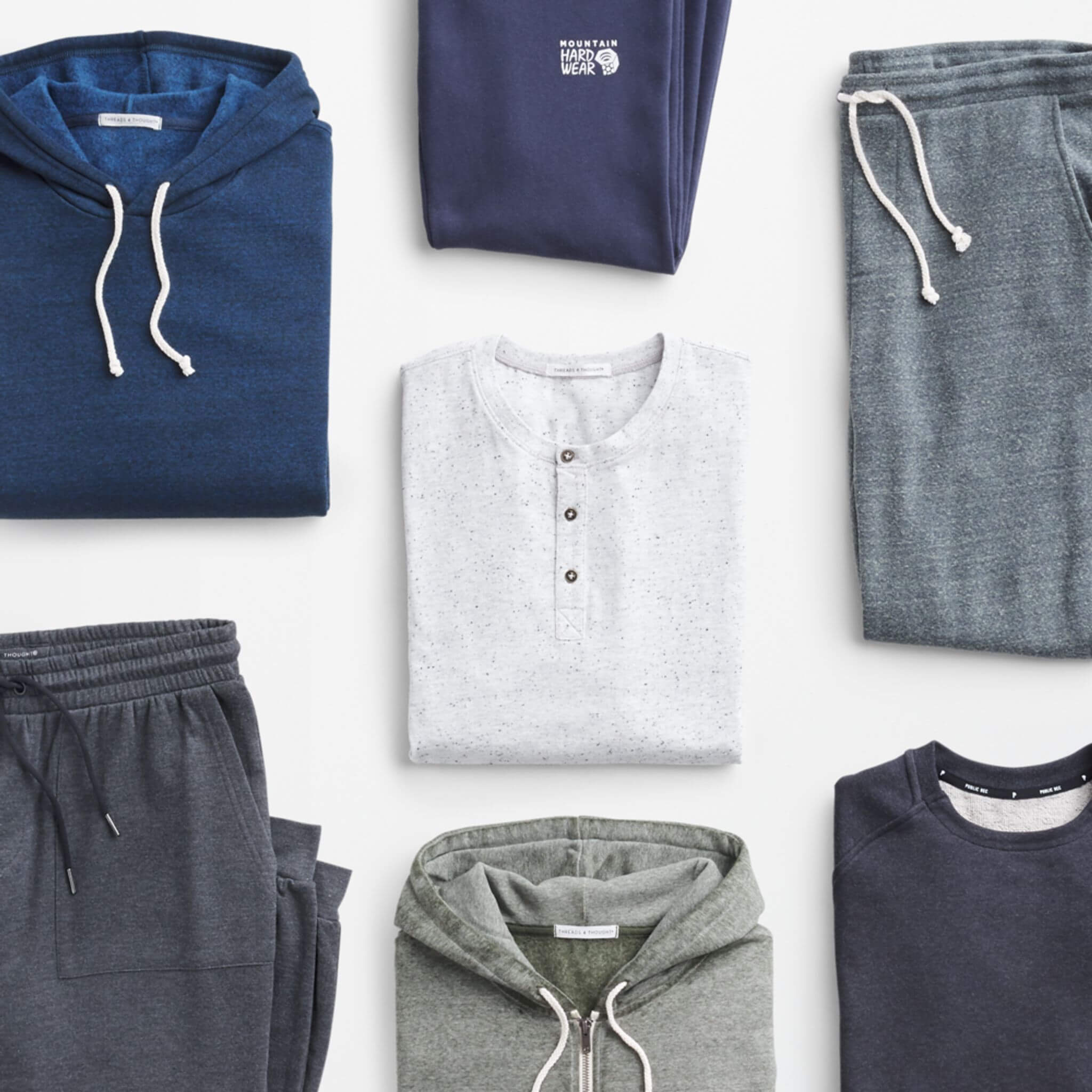 Stitch Fix Men's outfit laydown featuring a navy hoodie, navy sweatpants, grey joggers, navy pullover sweatshirt, front-zip hoodie and navy joggers.