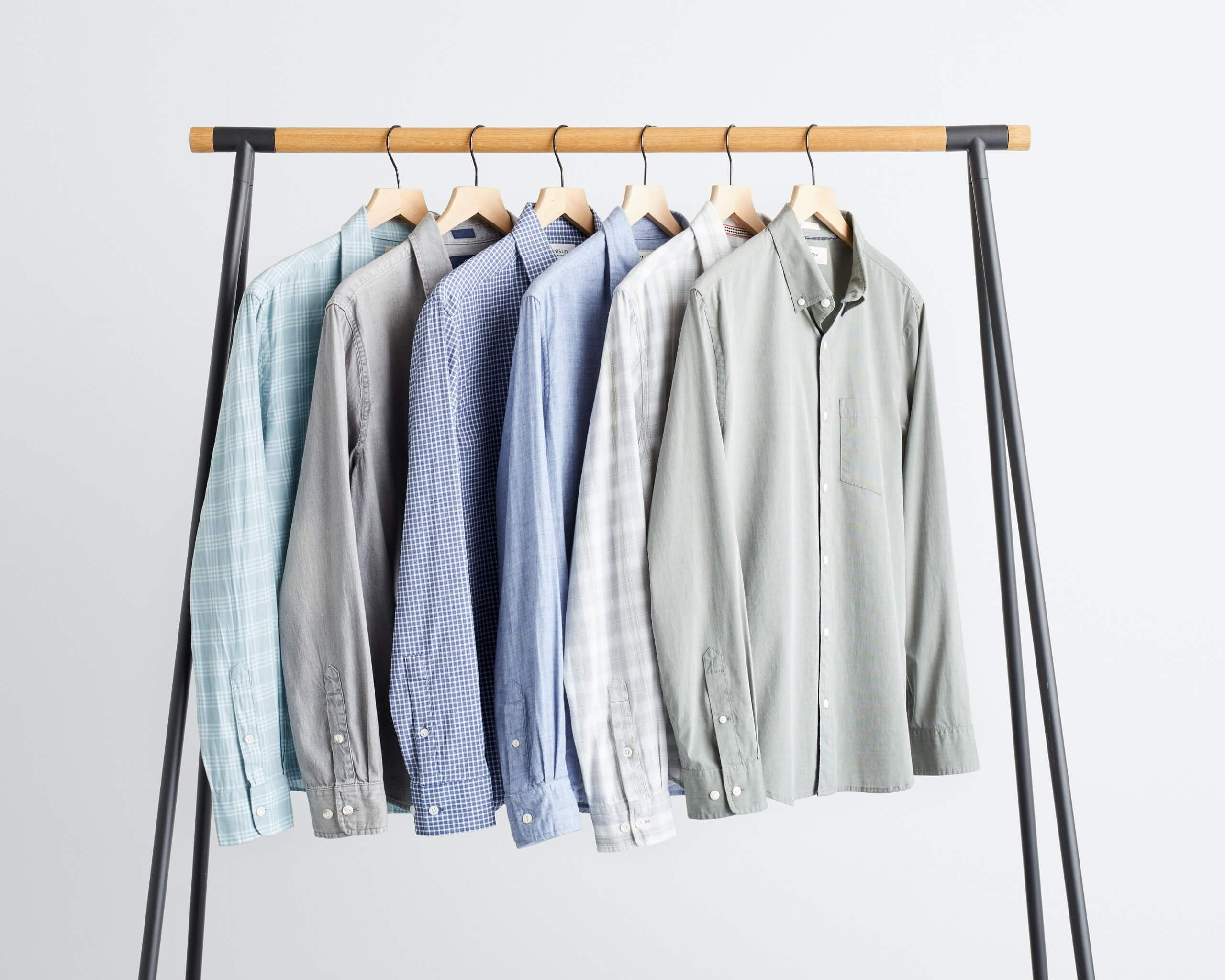 Stitch Fix Men's rack image with long sleeve button-down shirts in various shades of blue and grey.