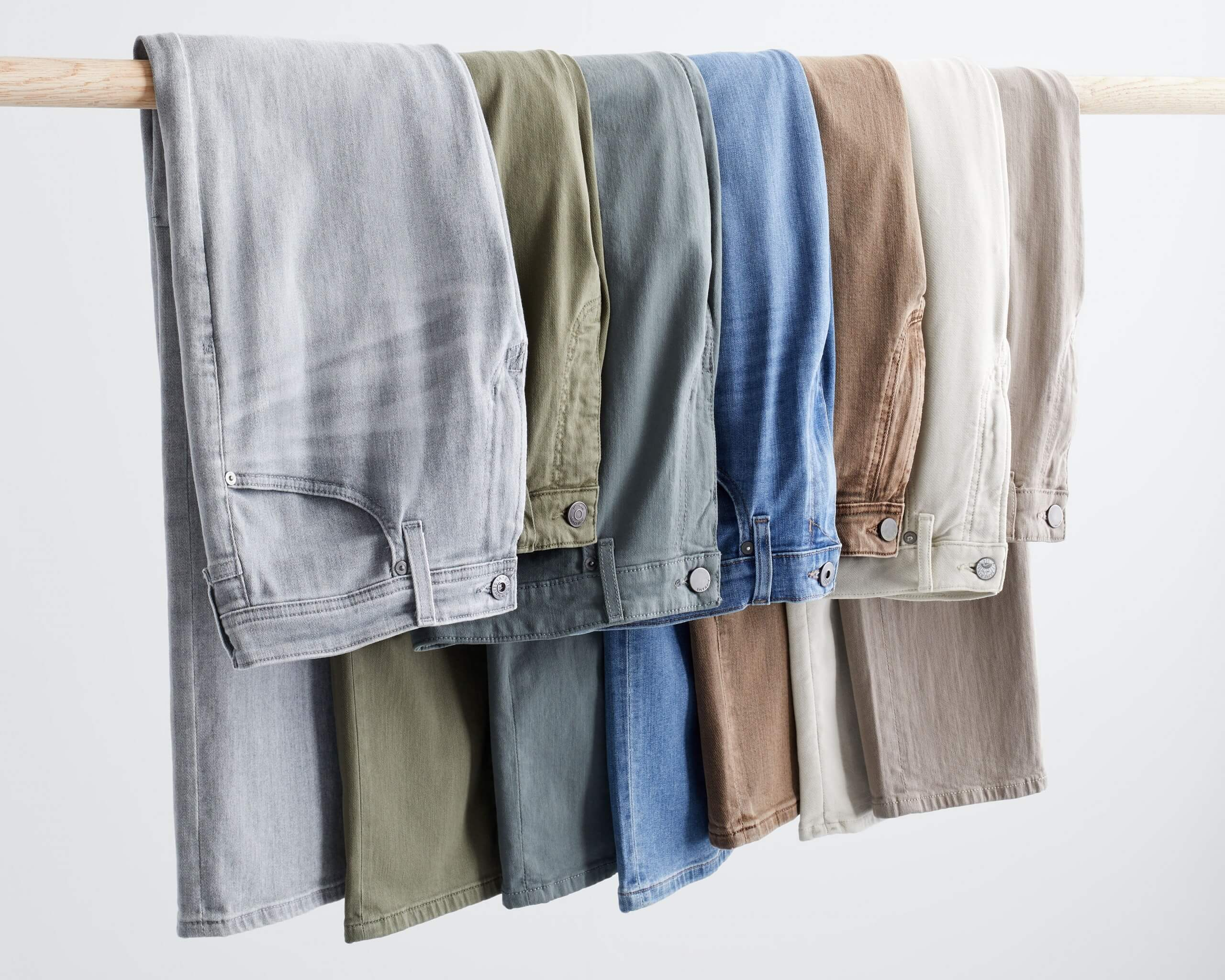 Stitch Fix rack image of grey jeans, green jeans, blue jeans, and brown jeans.