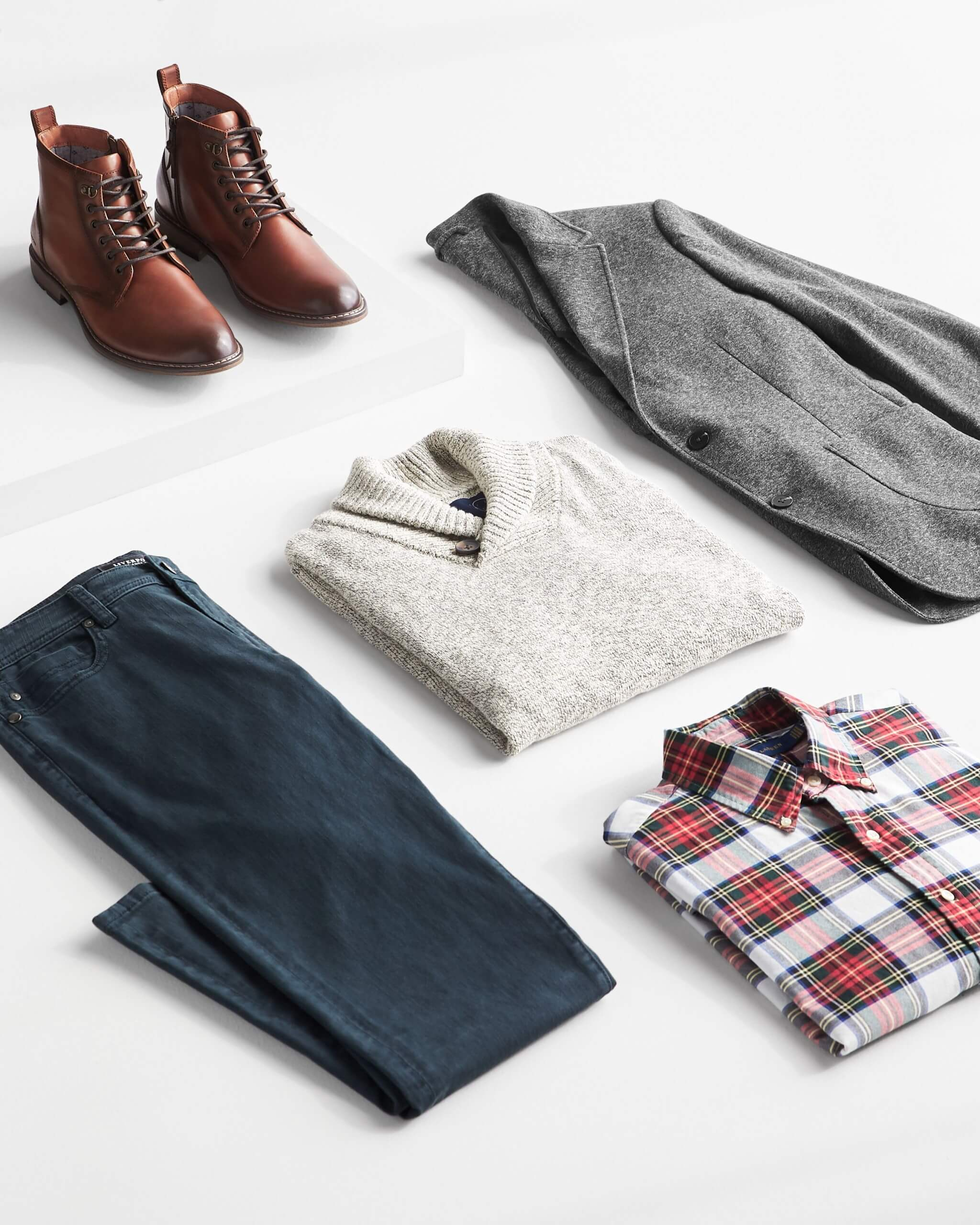 Stitch Fix men's outfit laydown featuring red plaid button-down shirt, grey pullover shawl, grey blazer, dark wash jeans and brown leather boots.