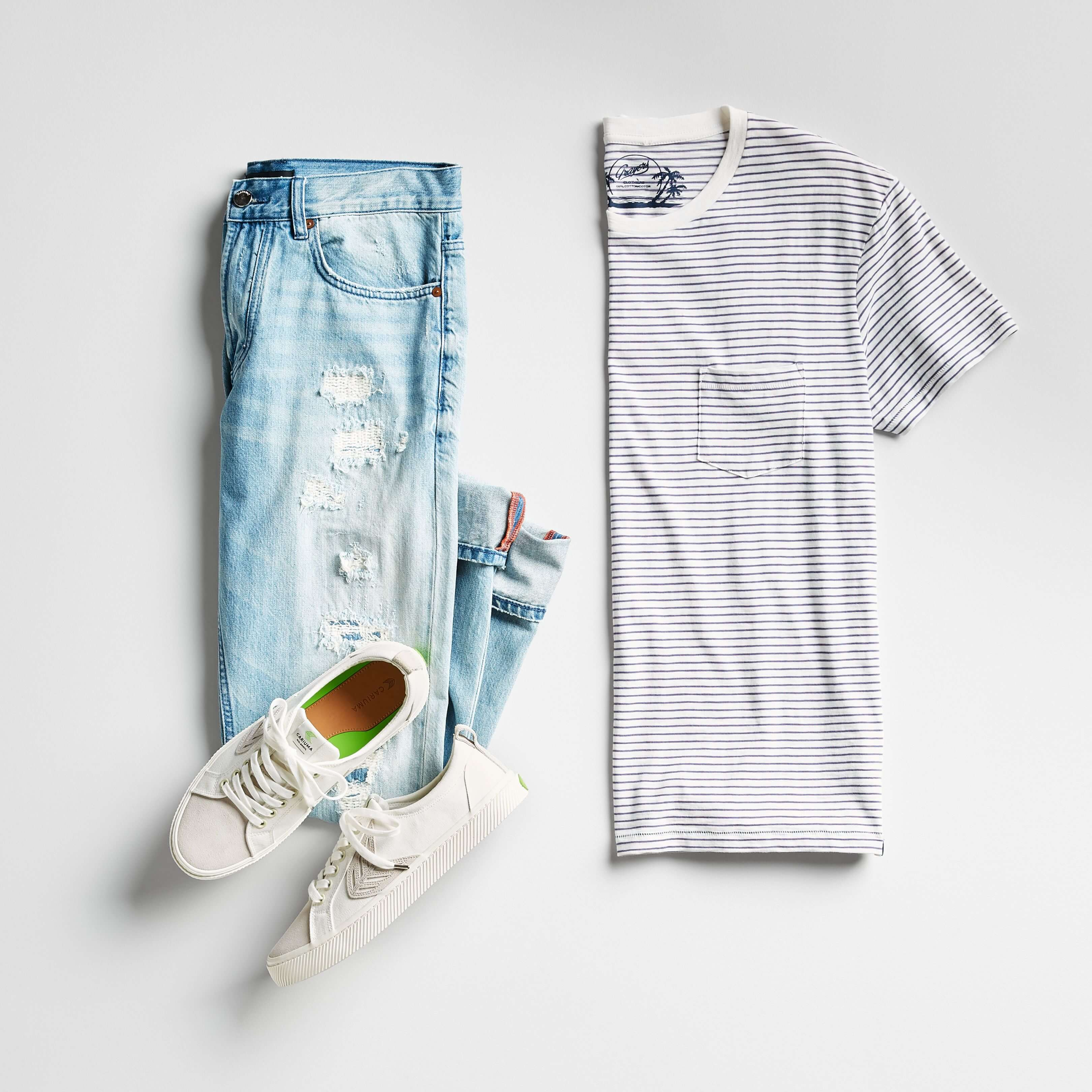 men's striped tee, distressed jeans and sneakers