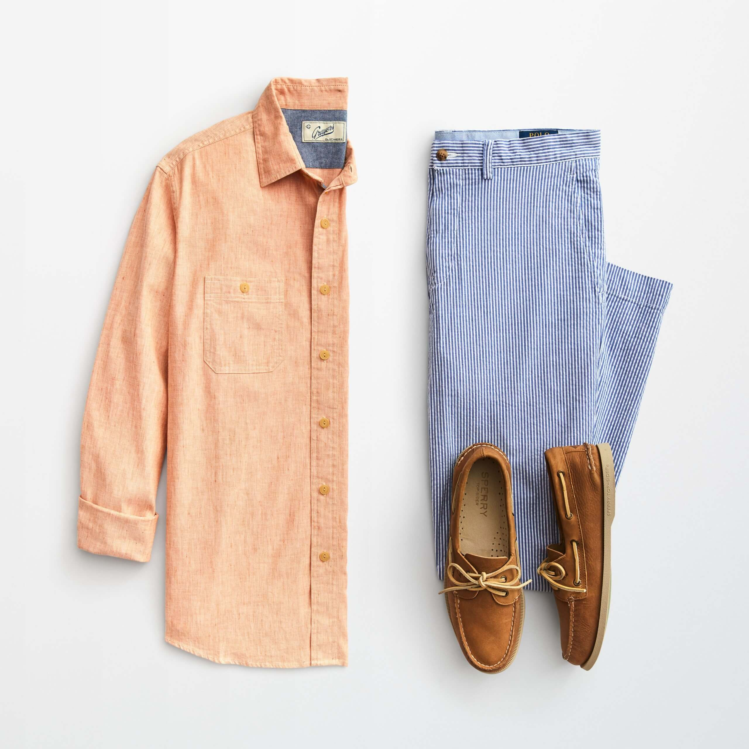 Stitch Fix Men's outfit laydown featuring an orange button-down shirt, blue striped chinos and brown boat shoes.