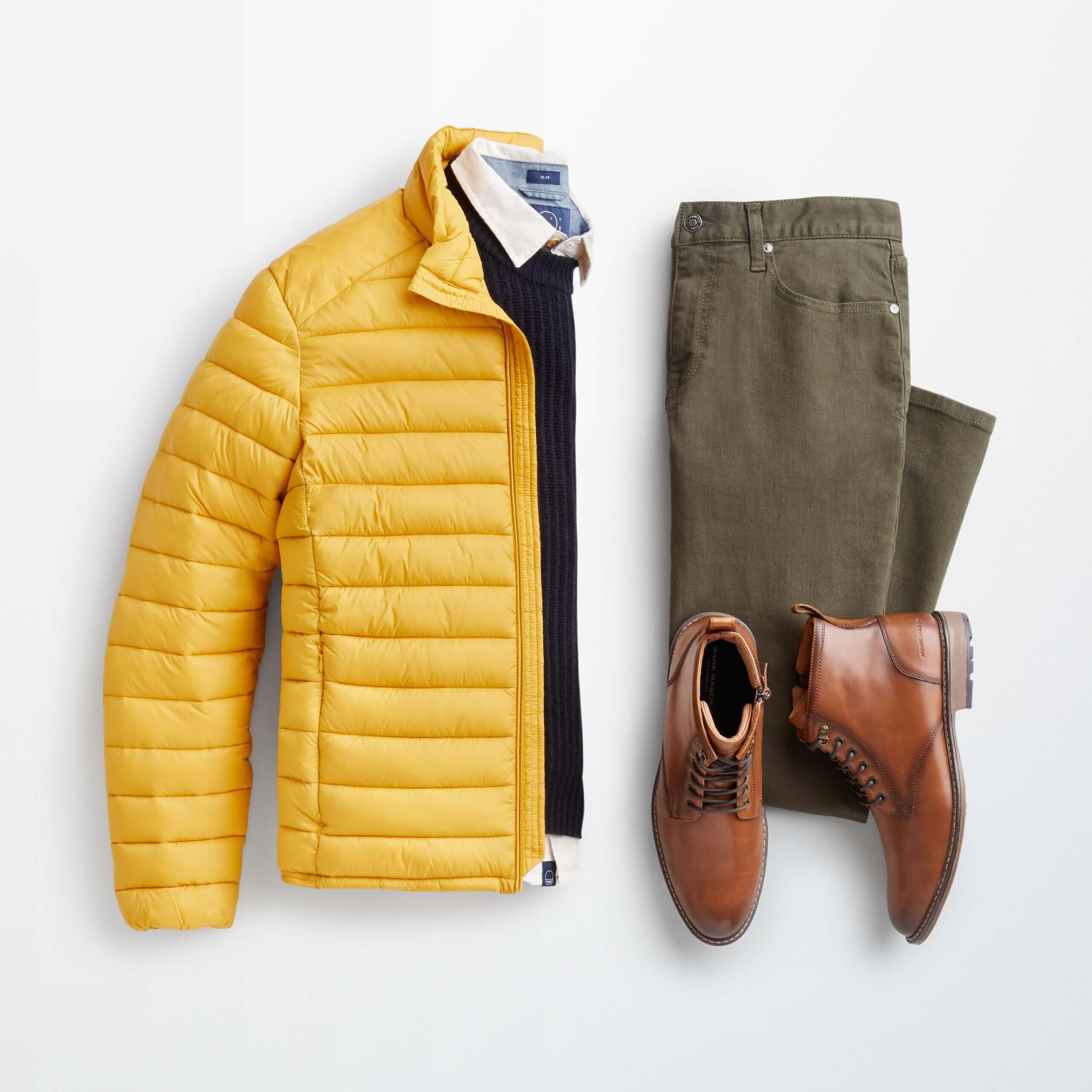Stitch Fix men's outfit laydown featuring yellow puffer jacket over blue pullover and collared shirt, olive jeans and brown leather boots.