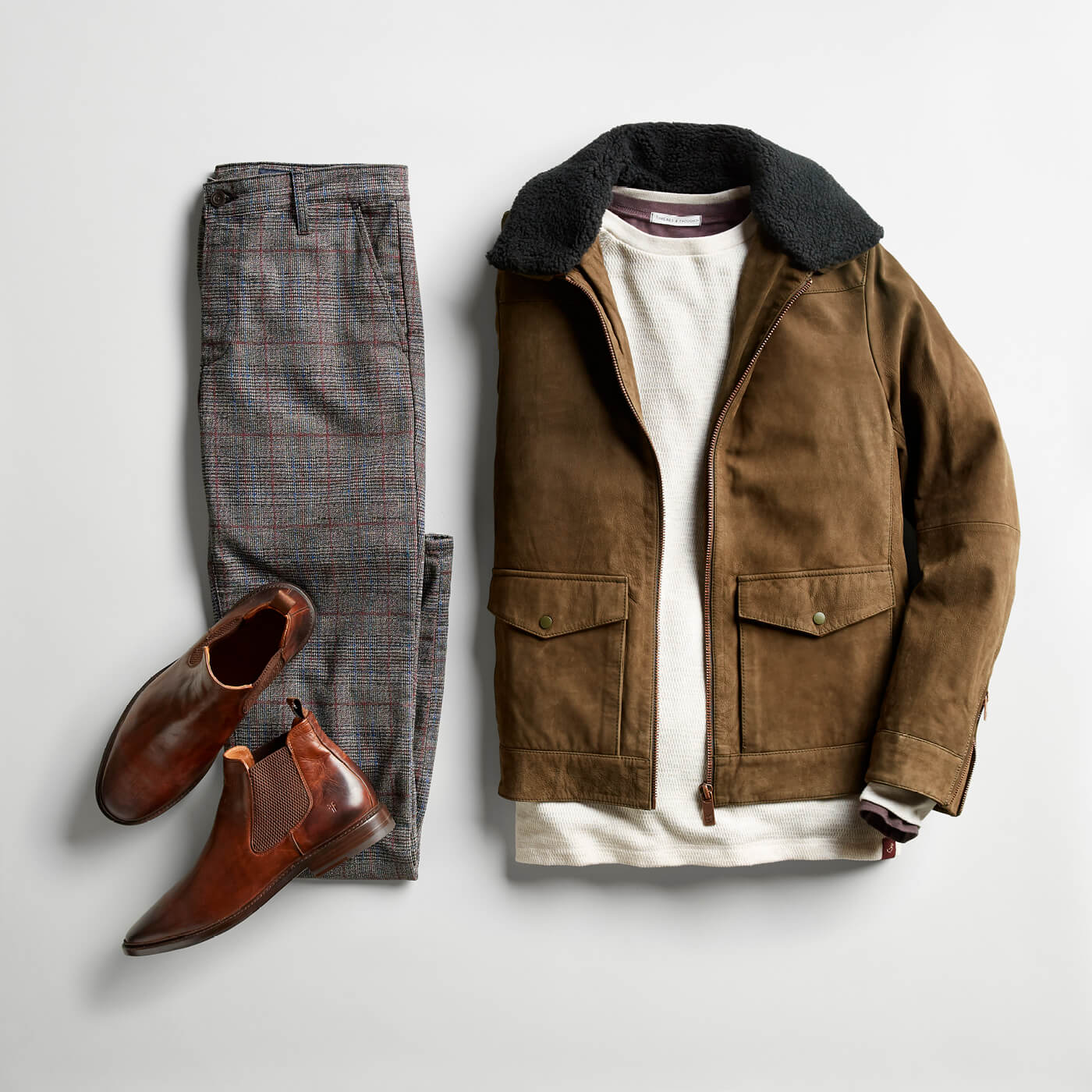 shearling jacket and grey pants