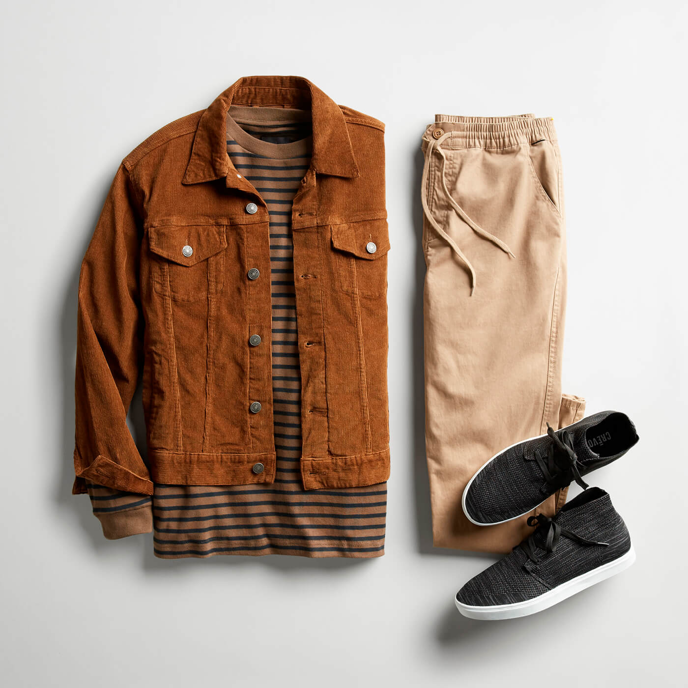 tan corduroy jacket and beige denim