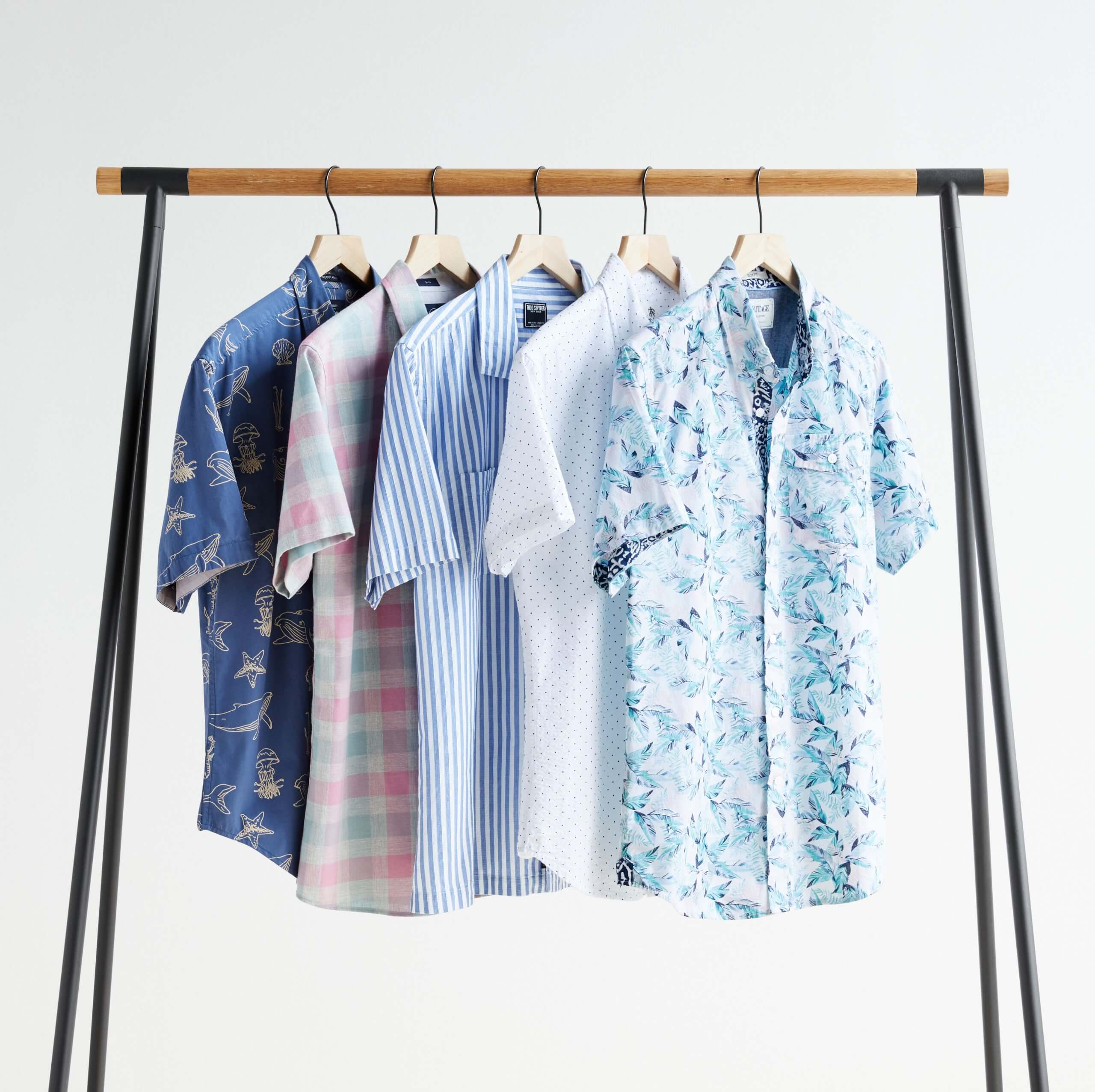 Stitch Fix Men's rack image with patterned short-sleeved button-down shirts in blue, white and pink.