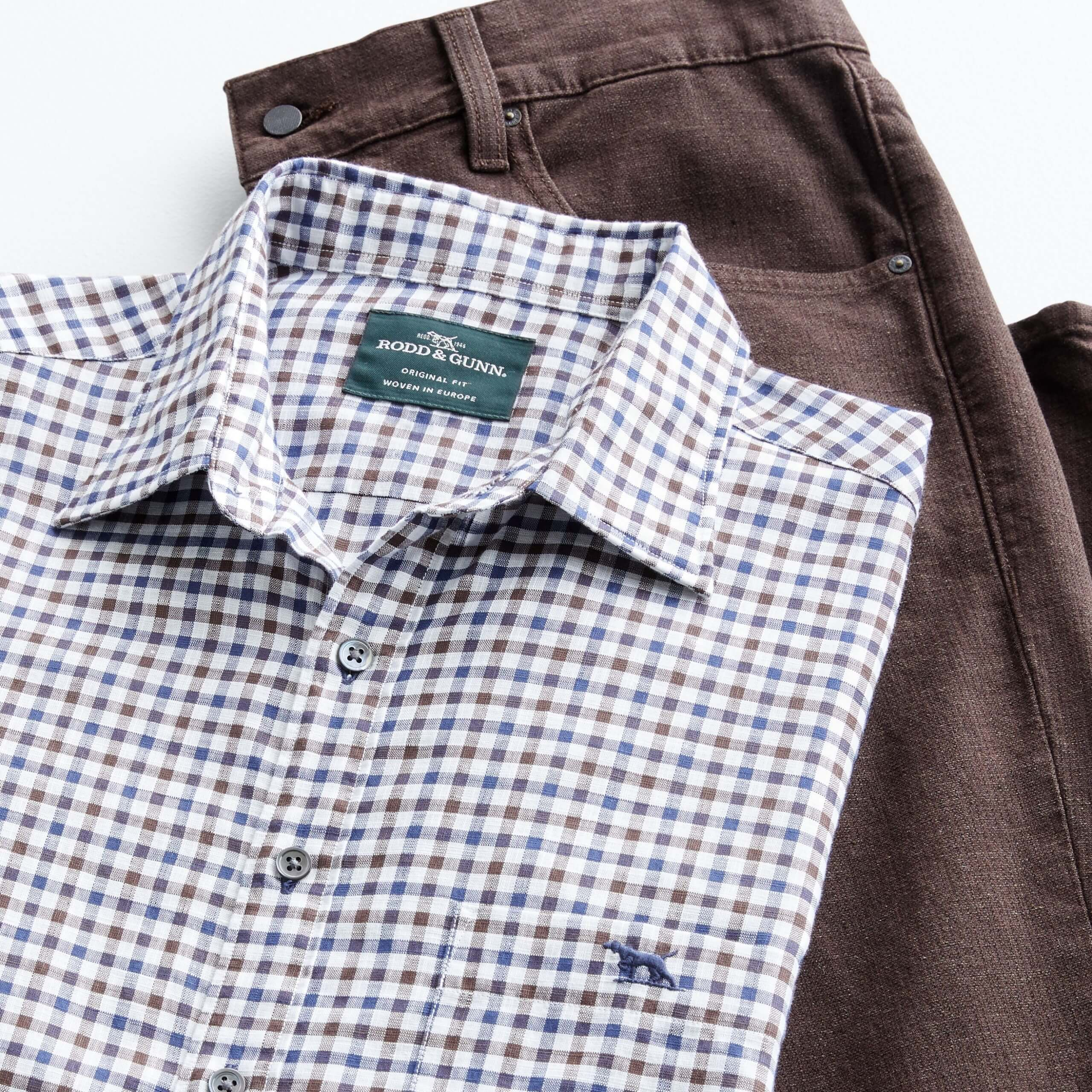Stitch Fix Men's outfit laydown featuring white, blue and brown check woven shirt and brown pants.