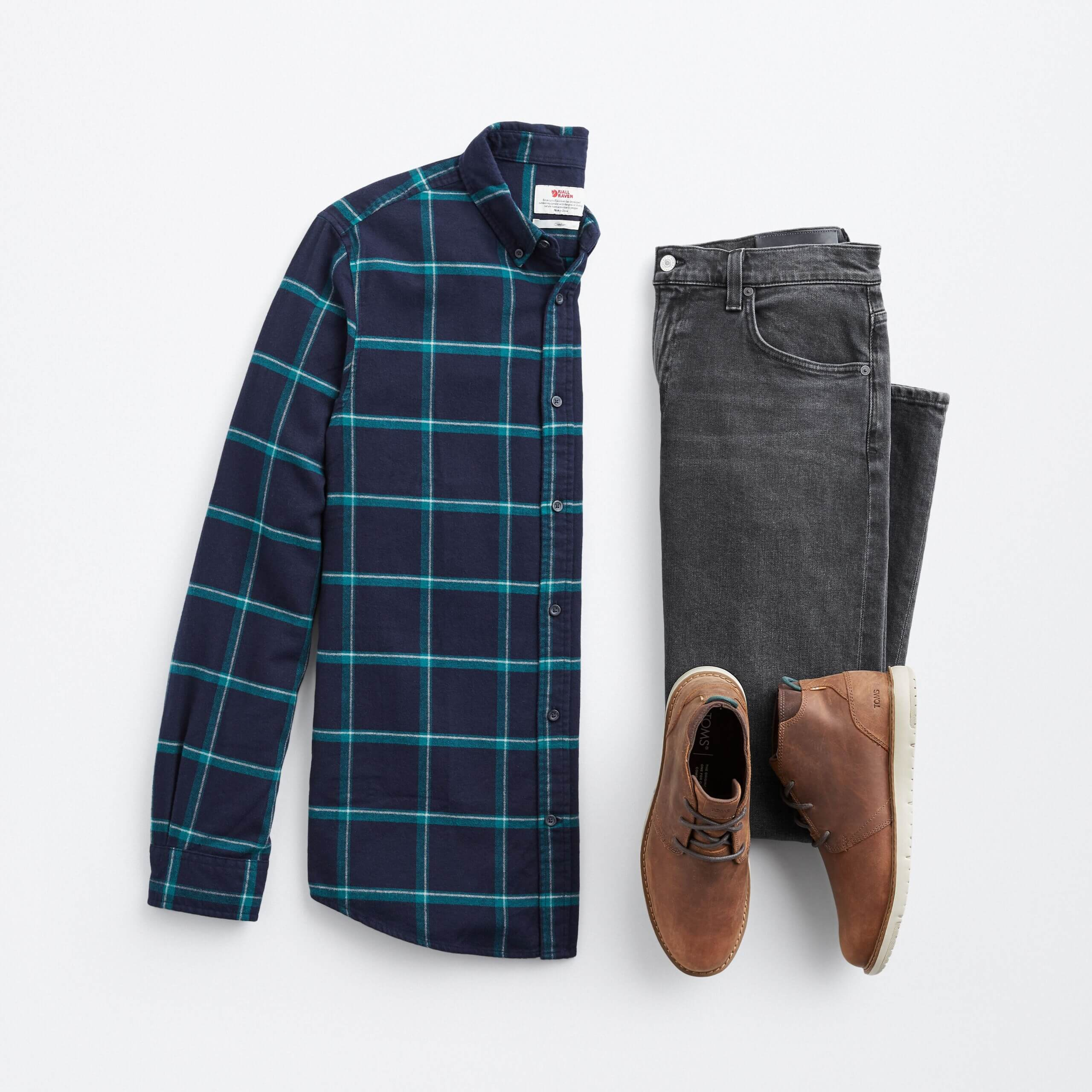 Stitch Fix men's navy and green plaid button-down with grey jeans and brown chukkas.