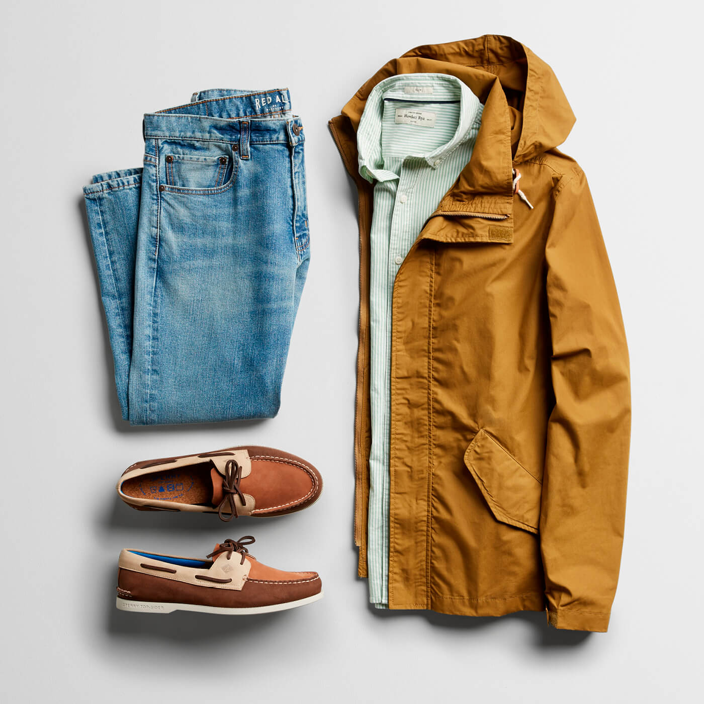 khaki jacket, green button down, light wash jeans and boat shoes