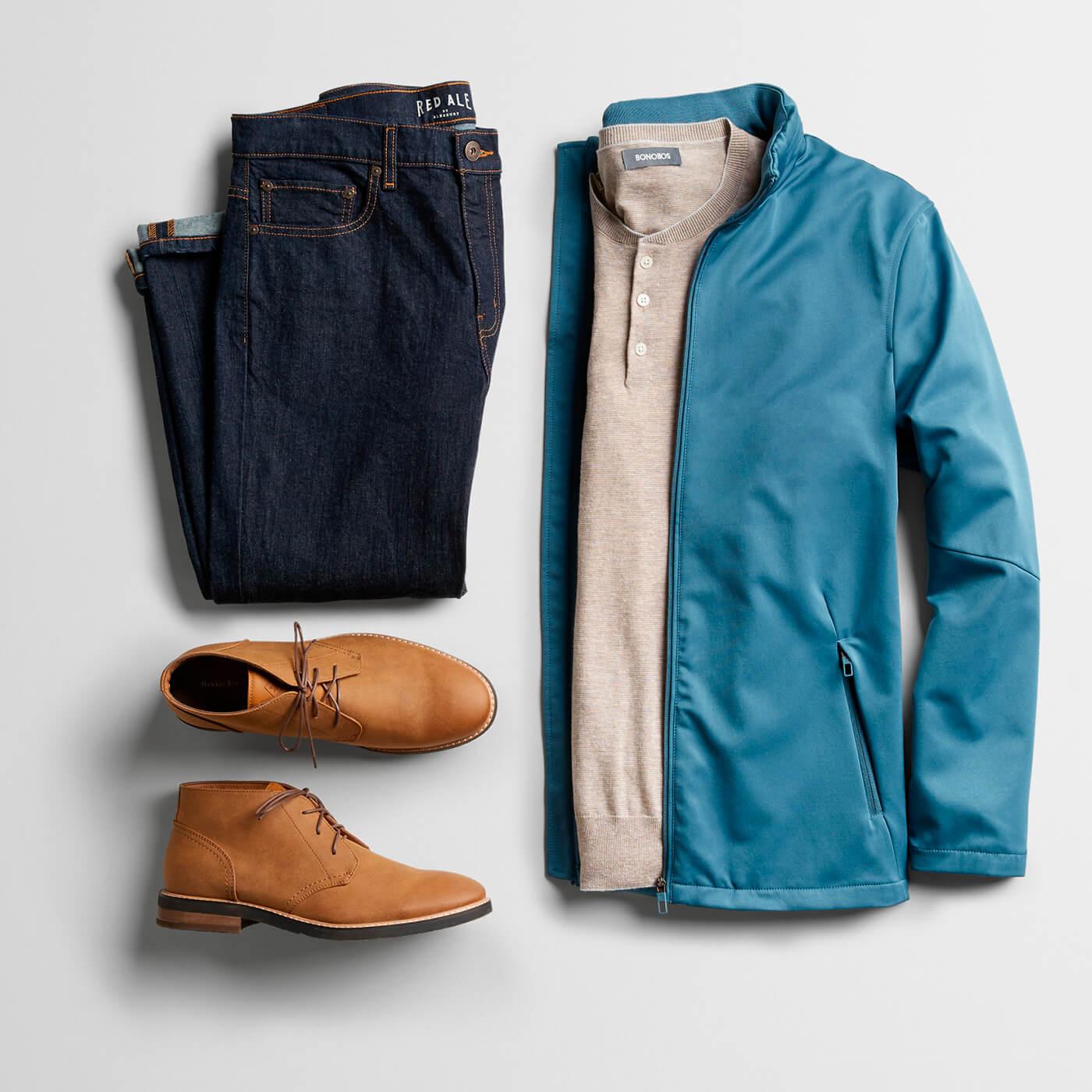light blue jacket, tan henley, navy chinos and tan chukka boots