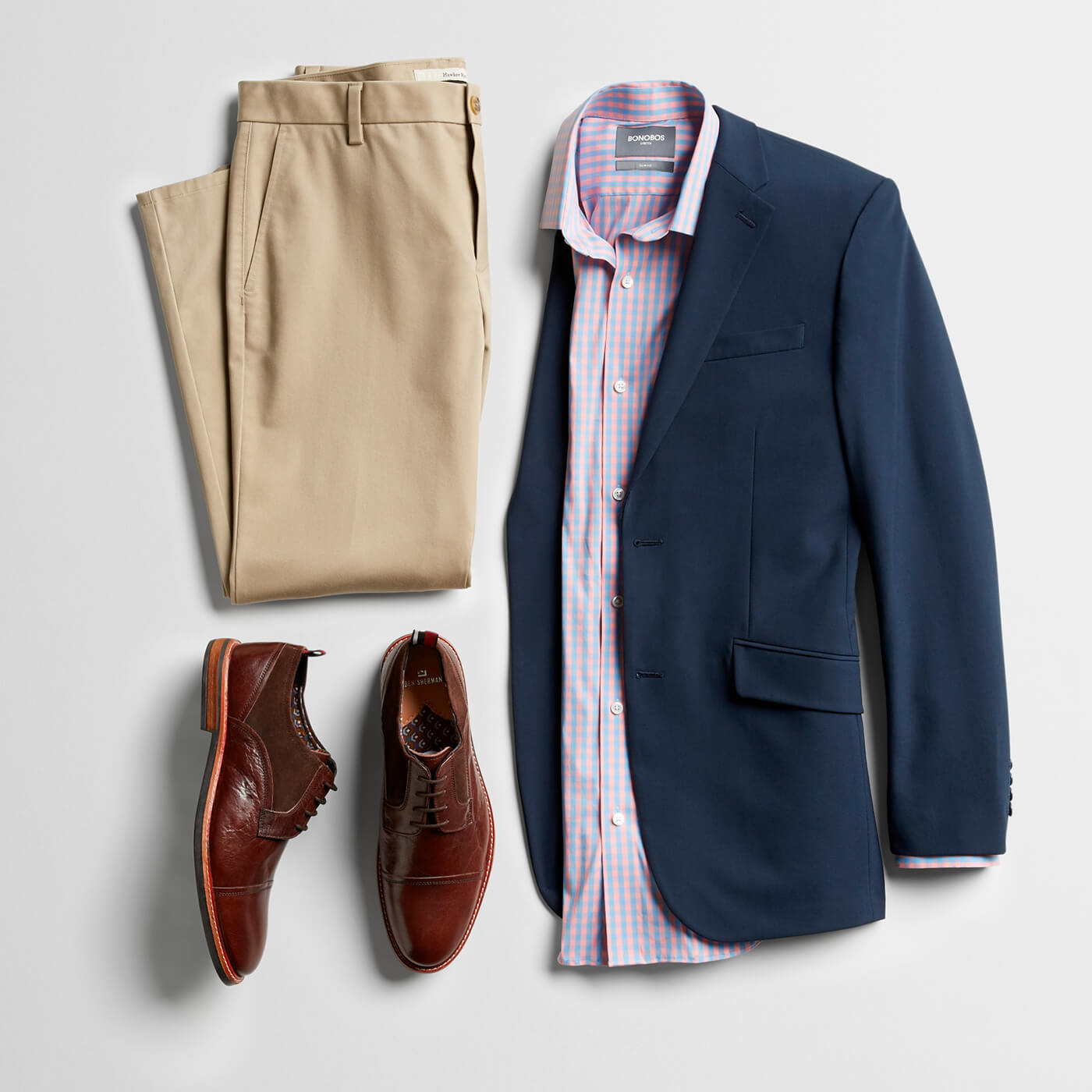 navy blazer, tan dress pants, brown loafers and pink dress shirt