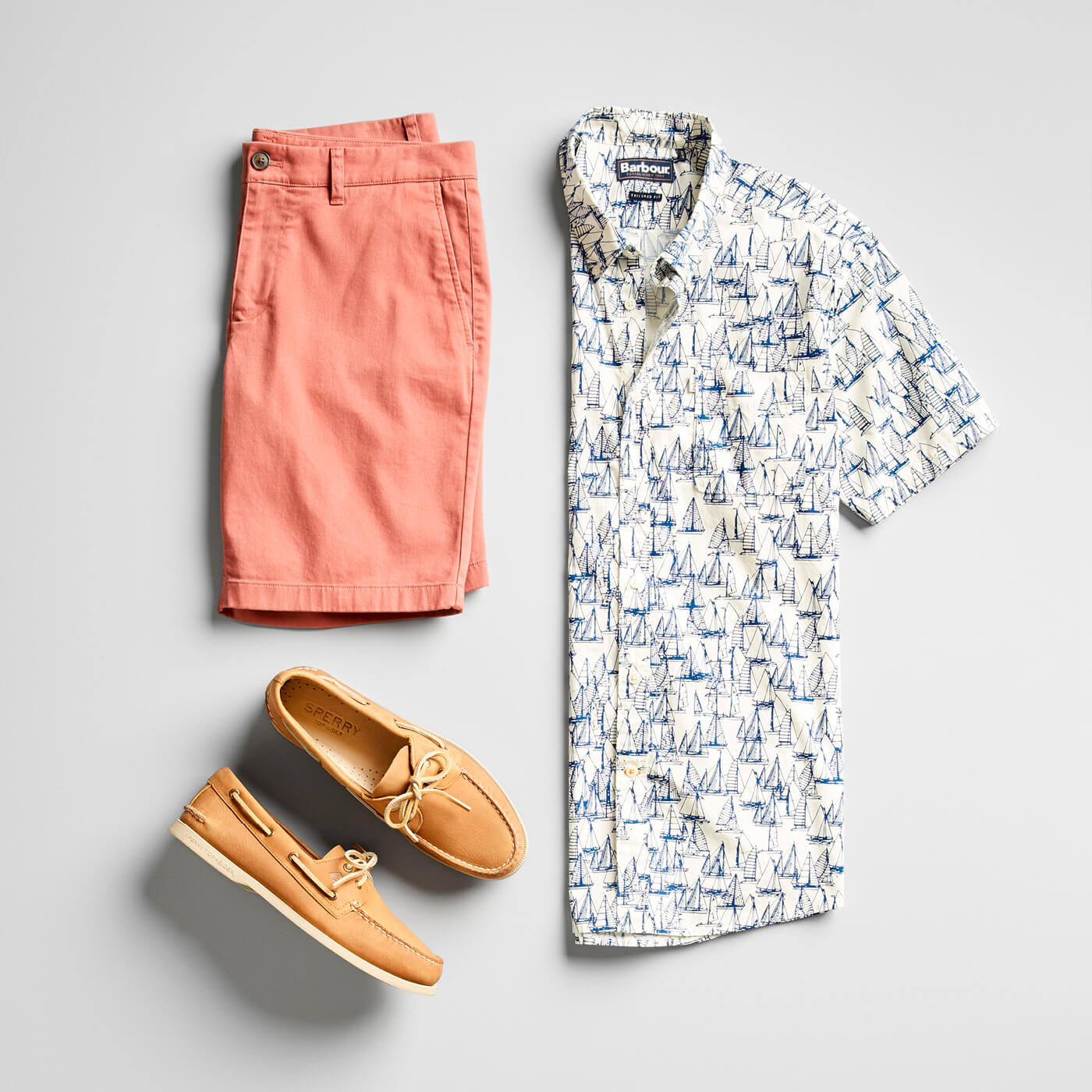 pink shorts and printed short sleeve button-up