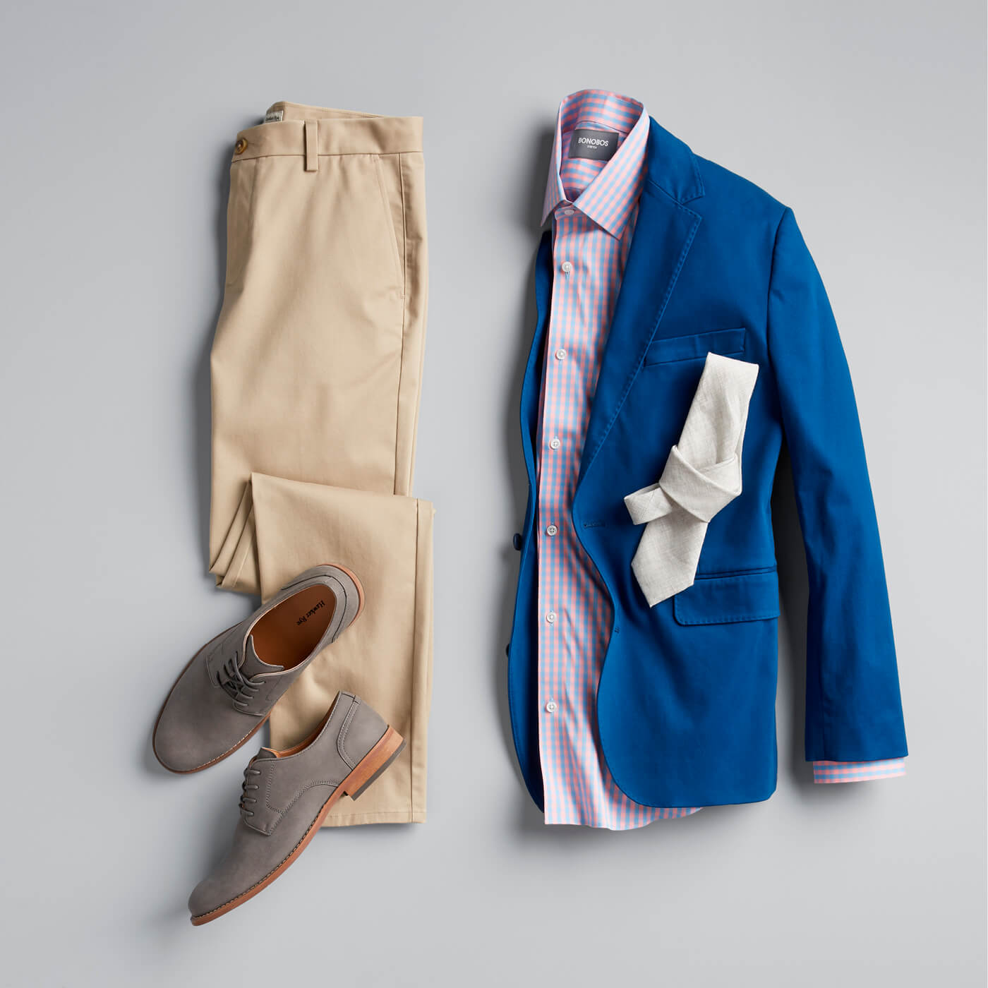 blue blazer, pink shirt, white tie with khaki chinos