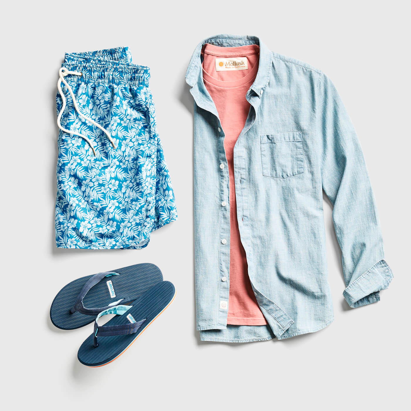 flip flops with swim trunks and chambray shirt
