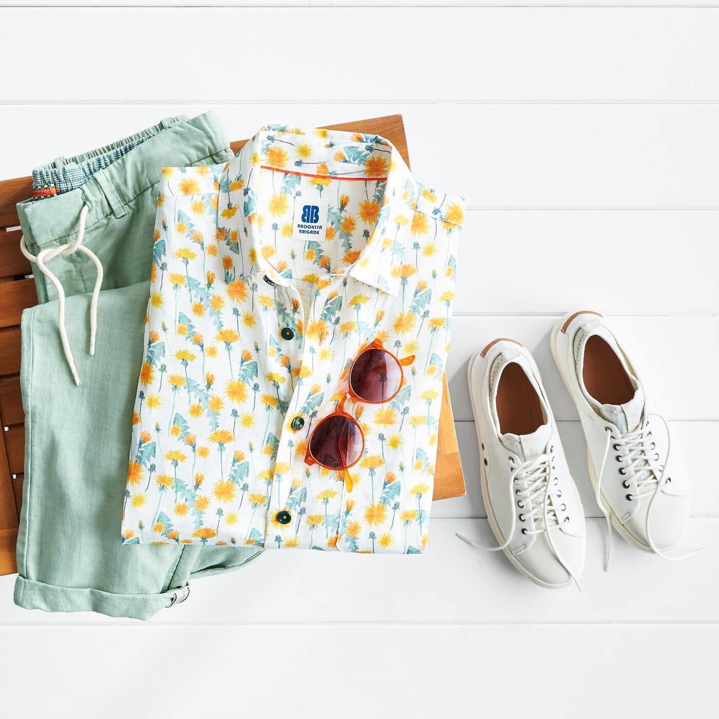 mens yellow floral shirt and green pants