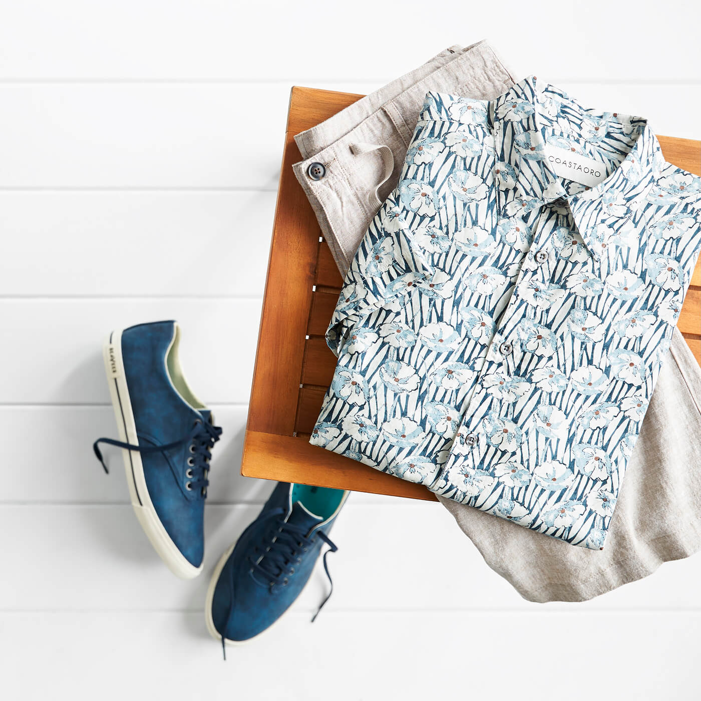 mens blue sneakers and blue floral shirt