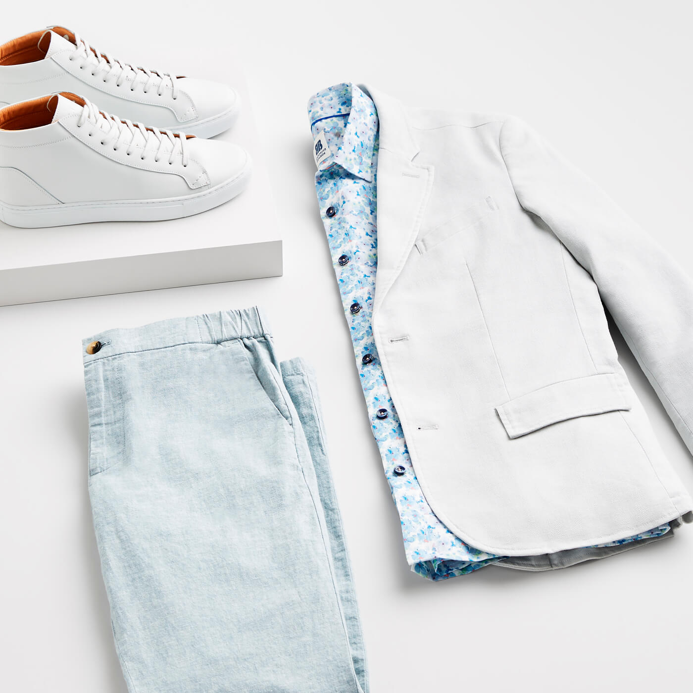 grey blazer and blue pants