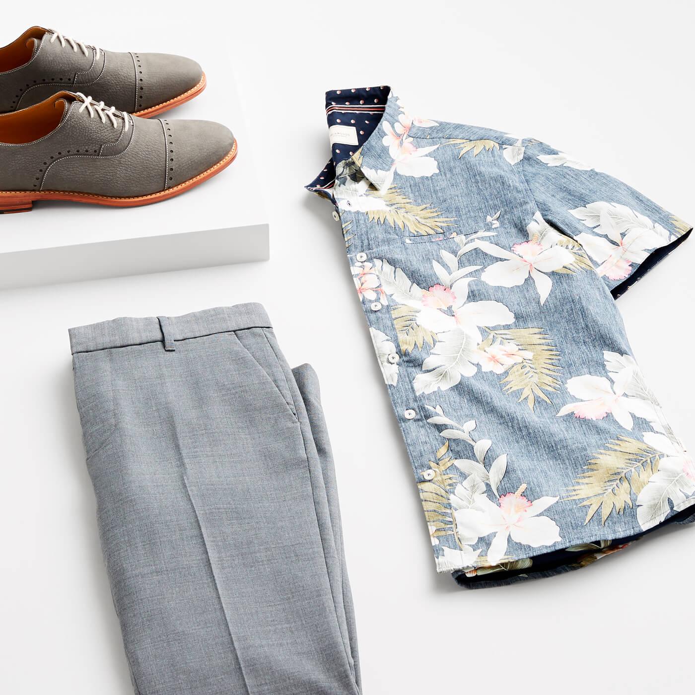 tropical shirt and grey slacks