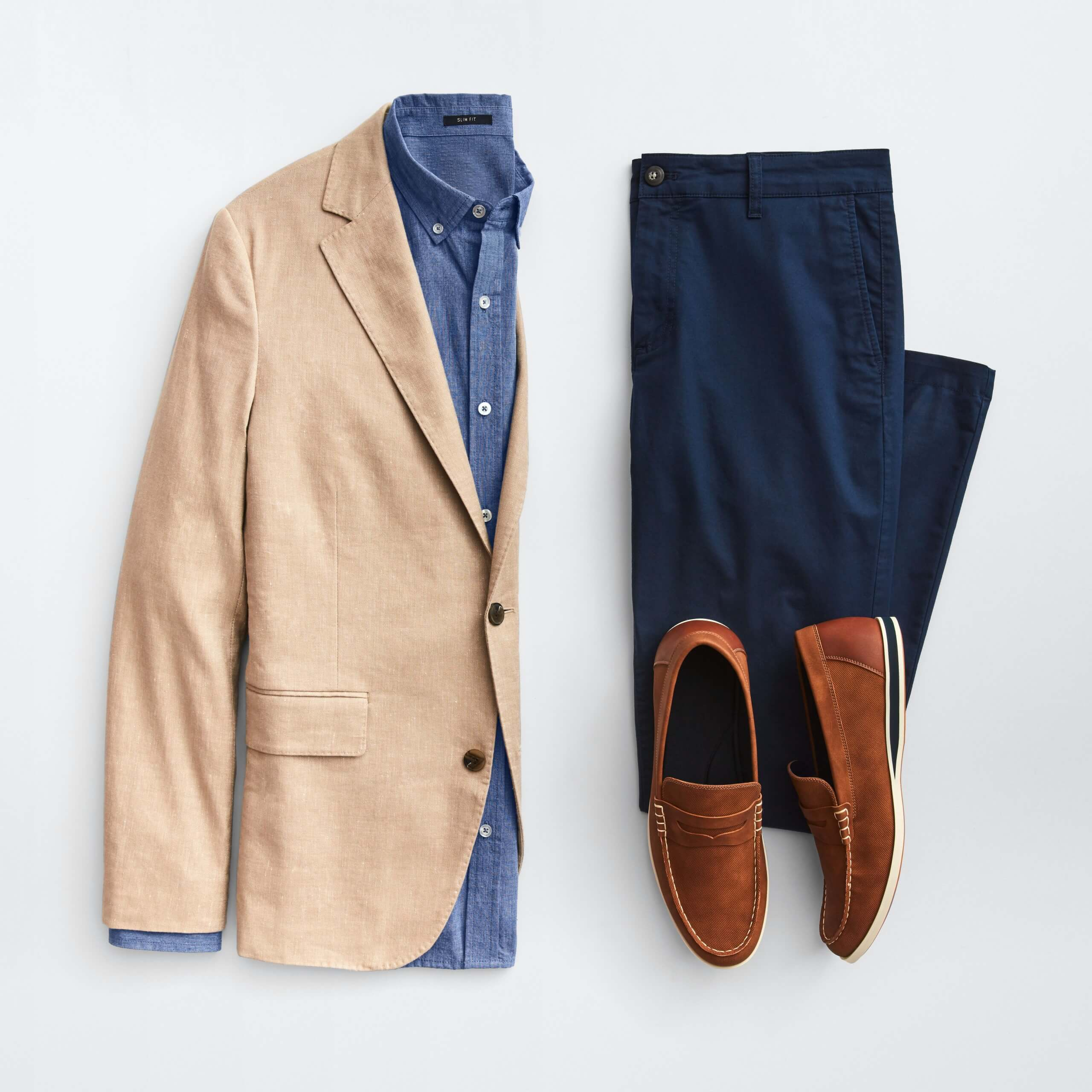 Stitch Fix Men's outfit laydown featuring a tan blazer over a navy button-down shirt, next to navy pants and brown loafers.