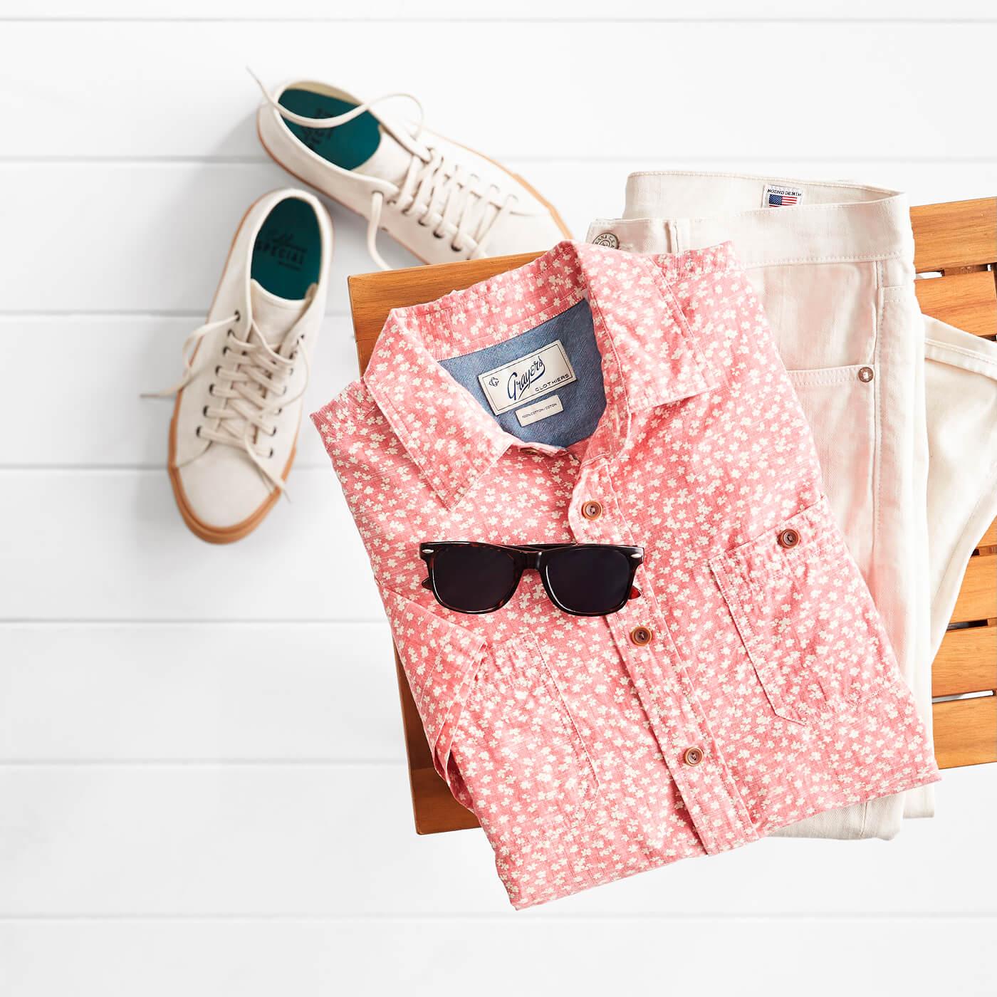 pink floral printed shirt and men's khaki pants