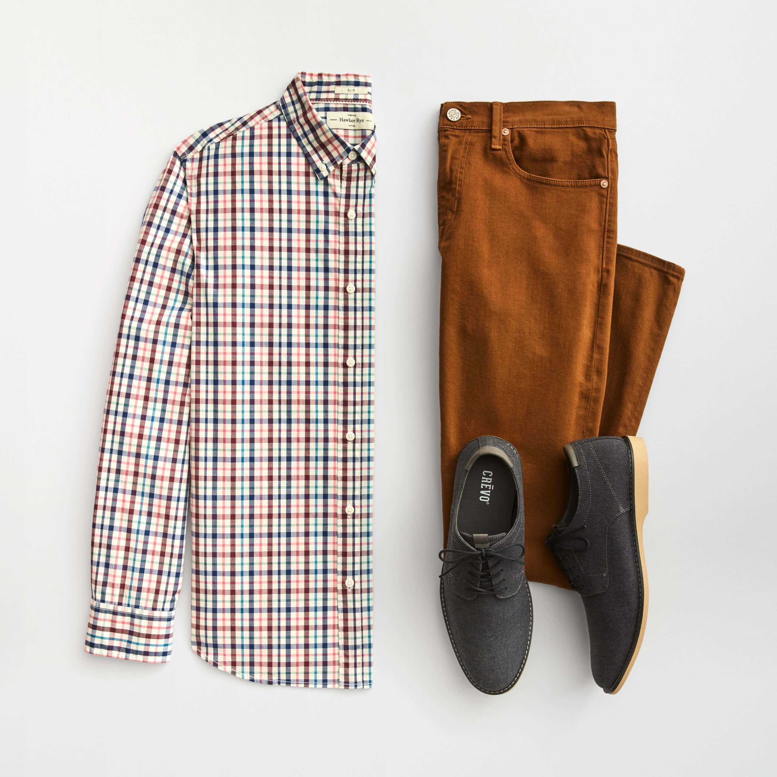 Stitch Fix Men's outfit laydown featuring multi-colored button-up shirt, brown colored skinny jeans and grey oxford shoes.