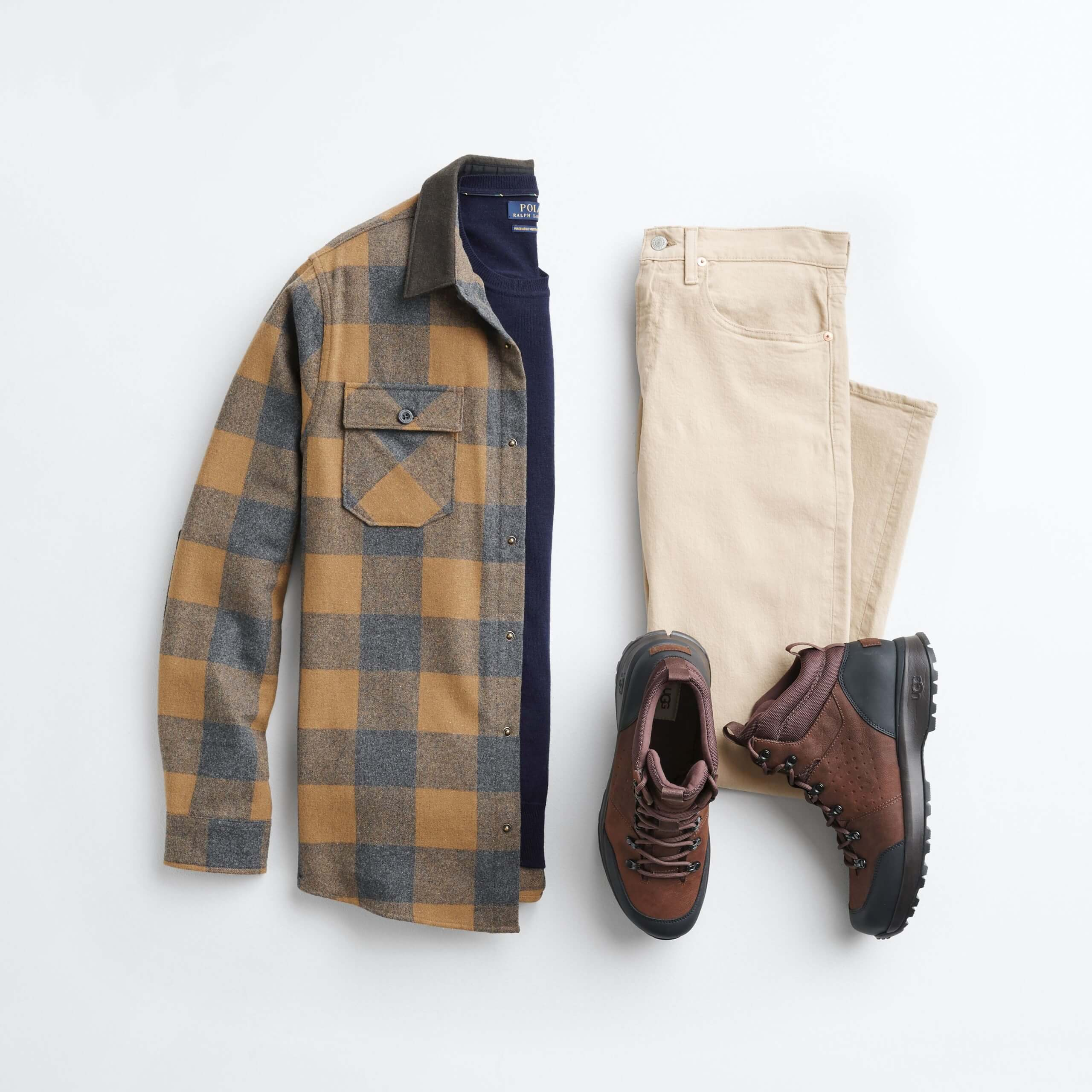 Stitch Fix Men's outfit laydown featuring mustard flannel over navy crewneck sweater, khaki jeans and brown hiker boots.