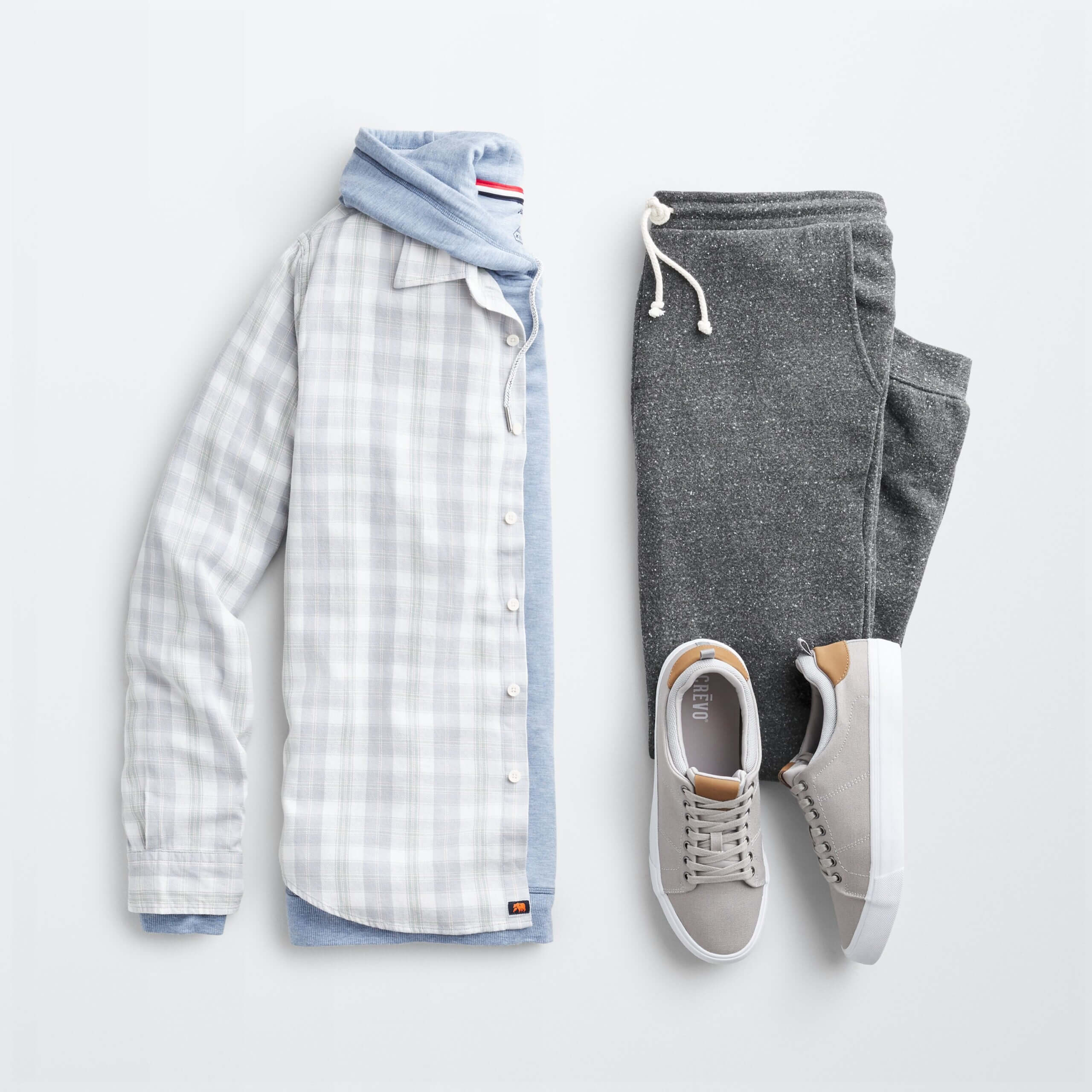 Stitch Fix Men's shacket outfit with blue and white plaid shacket, blue hooded sweatshirt, gray jogger pants, gray sneakers.