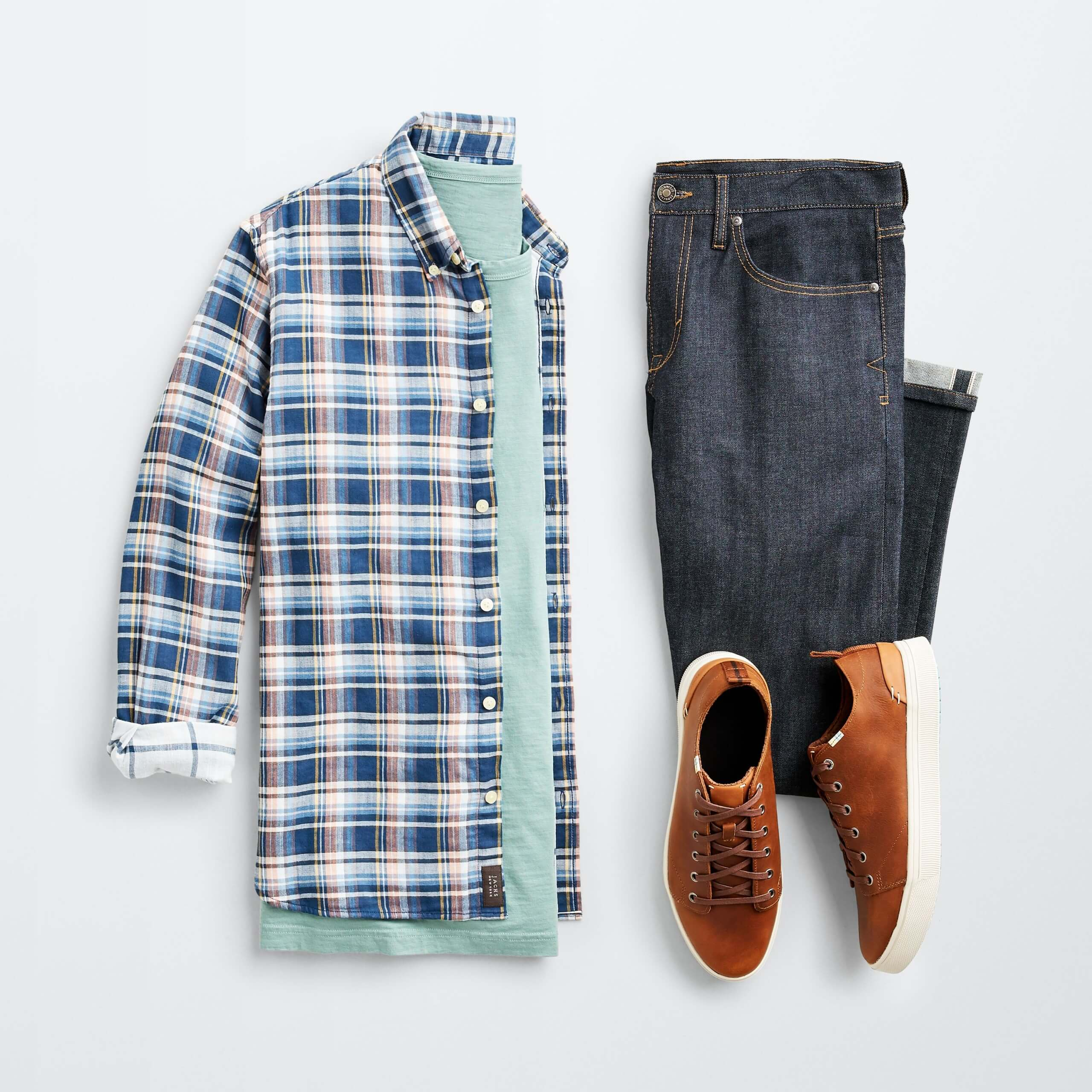 Stitch Fix Men's outfit laydown featuring plaid shacket over mint green t-shirt, dark blue jeans and brown sneakers.