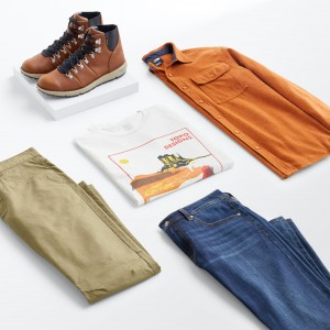Stitch Fix Men's Bohemian style outfit laydown with blue jeans, olive pants, graphic T-shirt, burnt orange shirt jacket and brown leather boots.