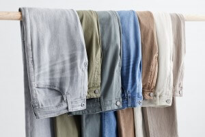 Stitch Fix Men's assortment of grey, olive, blue, brown, off-white and taupe washes draped over a hanger.