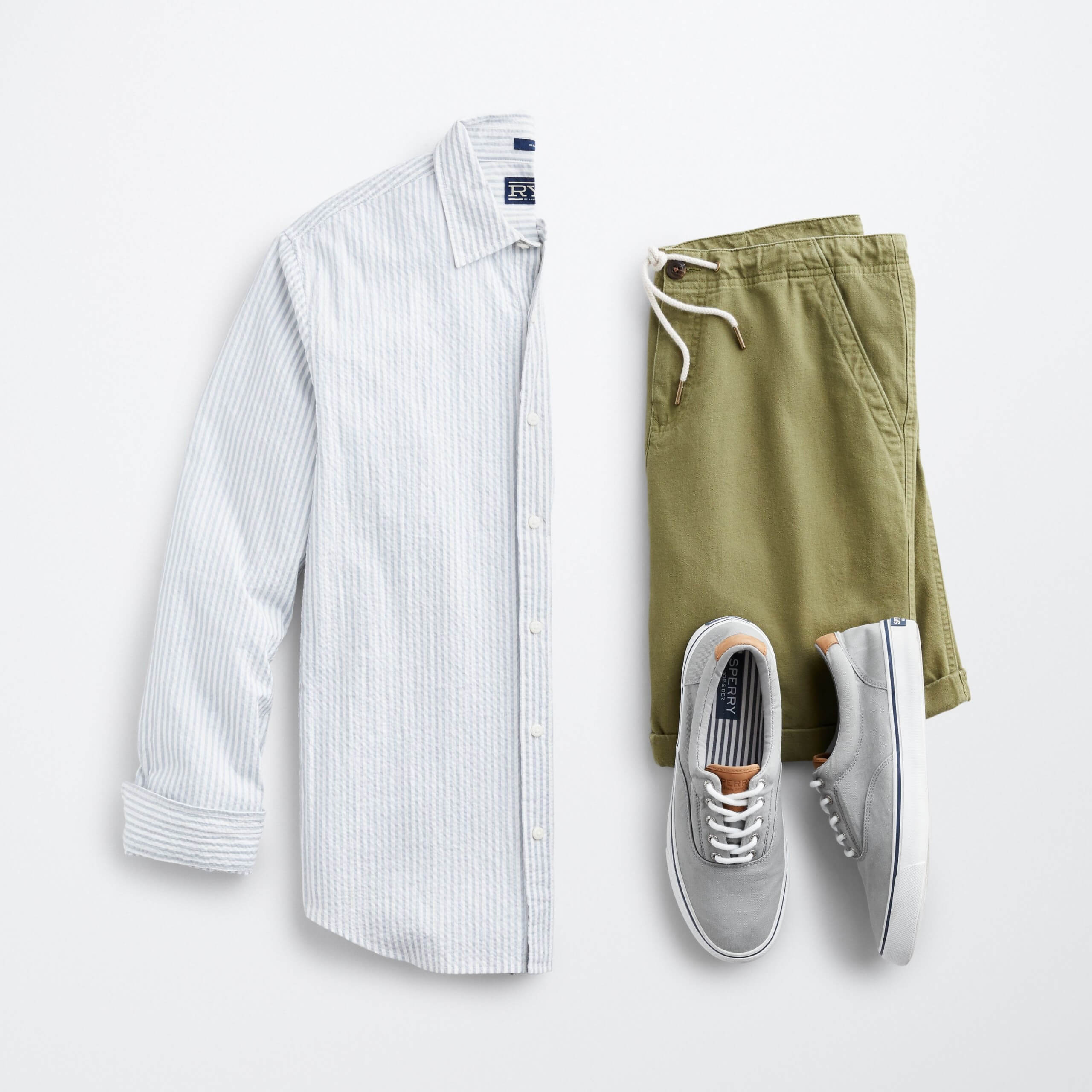 Stitch Fix Men's outfit laydown featuring white and blue striped long-sleeve button-down, olive shorts and grey sneakers.