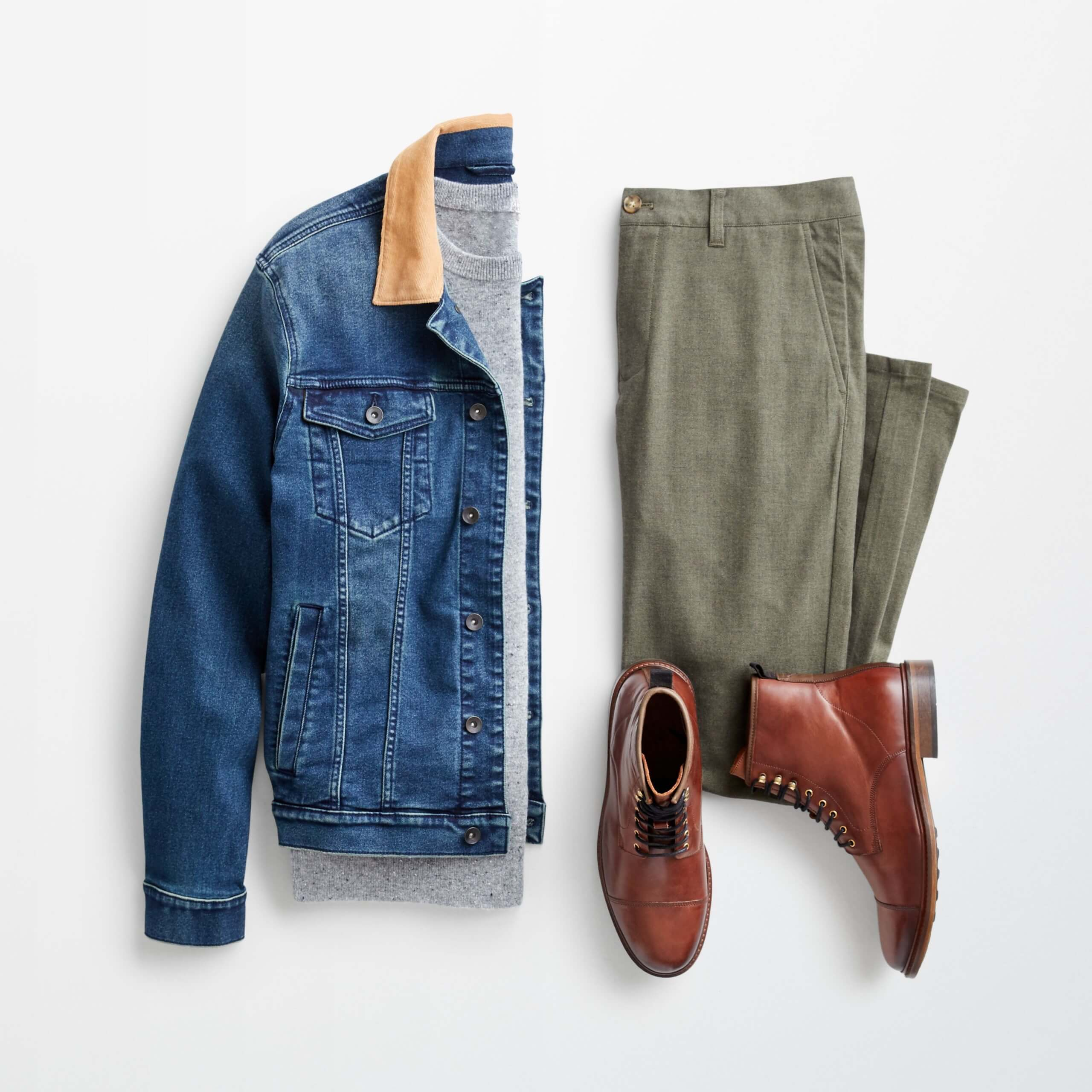 Stitch Fix jean jacket men's outfit laydown featuring blue jean jacket with a contrasting tan collar, grey T-shirt, olive pants and brown leather lace-up boots.