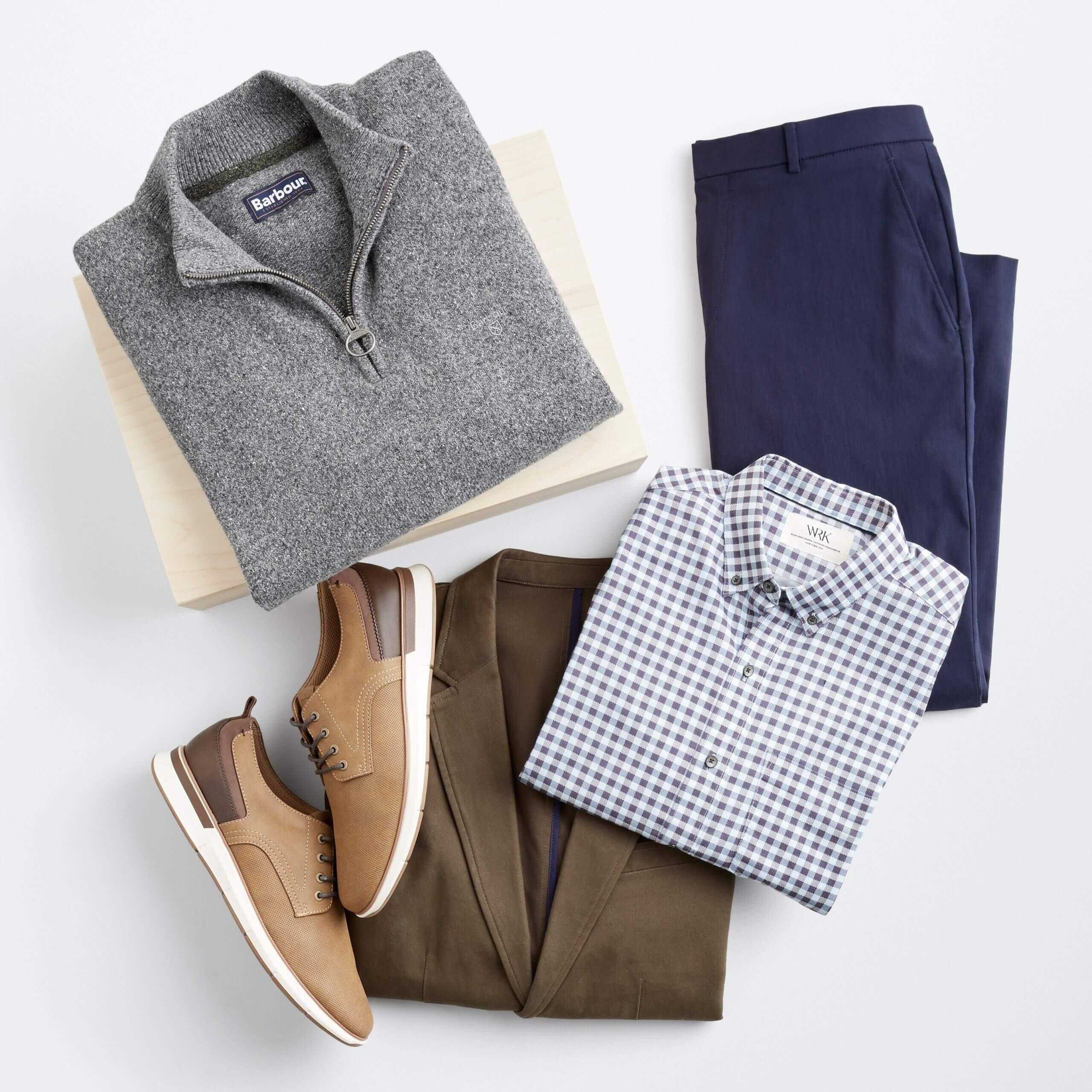 Stitch Fix men's winter outfit with grey quarter zip, navy trousers, blue and white button-down shirt, brown blazer and light brown shoes.