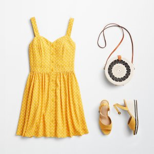 Stitch Fix women's outfit laydown featuring yellow button front dress, round crossbody woven handbag and yellow wedges.