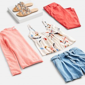Stitch Fix women's 4th of July outfit laydown featuring red, white and blue printed tank, blue denim shorts, coral sweater, red pants and sandals.