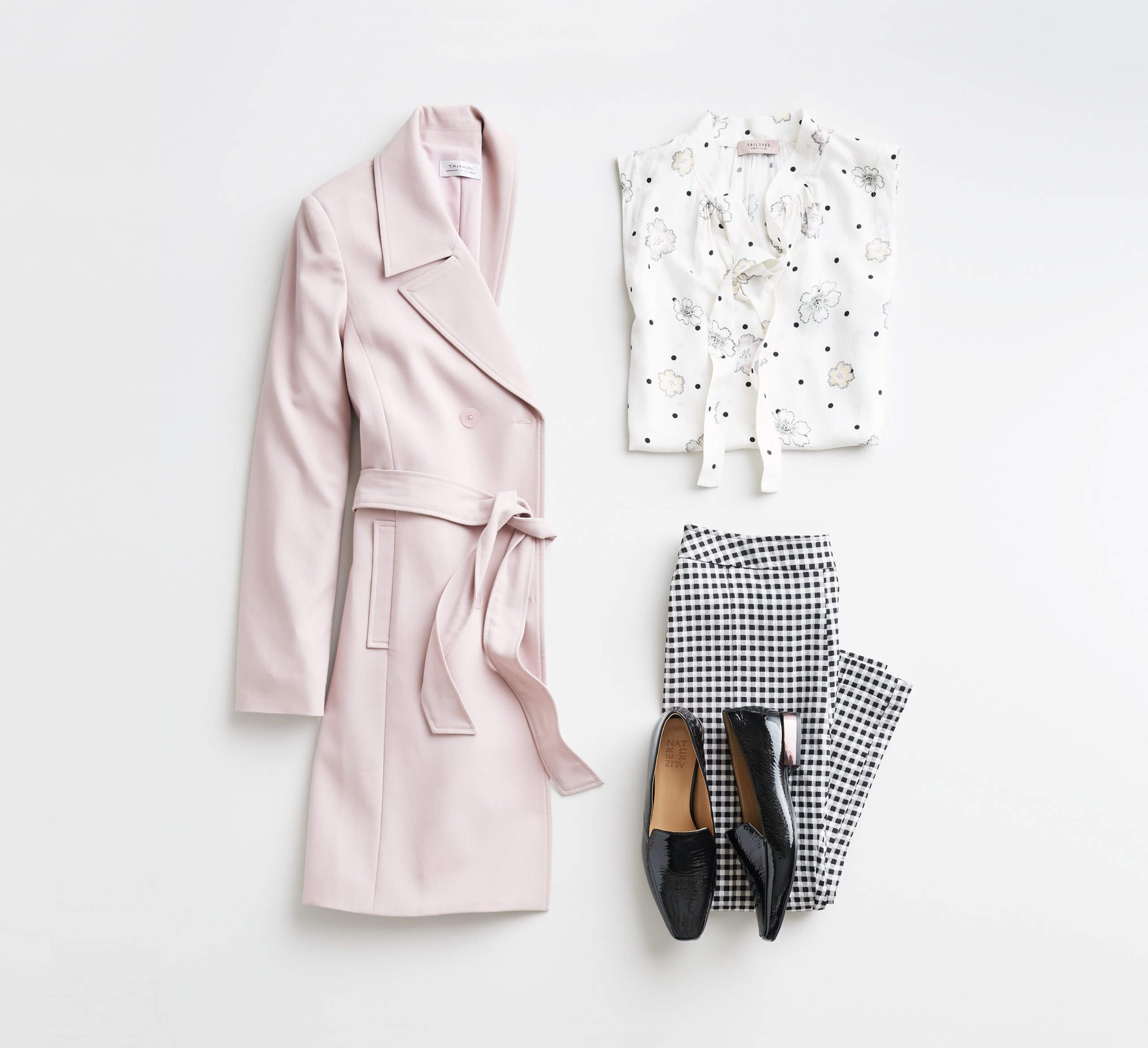 Stitch Fix Women's outfit laydown featuring pink trench jacket, white patterned tie-neck blouse, black and white checkered pants and black loafers.