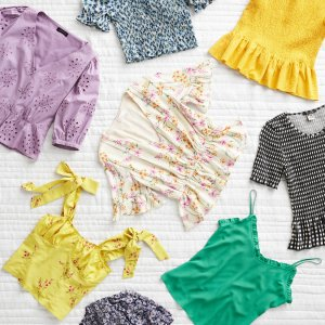Stitch Fix women's styles in an array of purple, yellow, green, white and floral printed blouses.