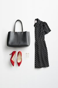 Stitch Fix women's accessories to wear with black dress featuring silver and gold hair clips, red heels, black tote with black polka dot dress.