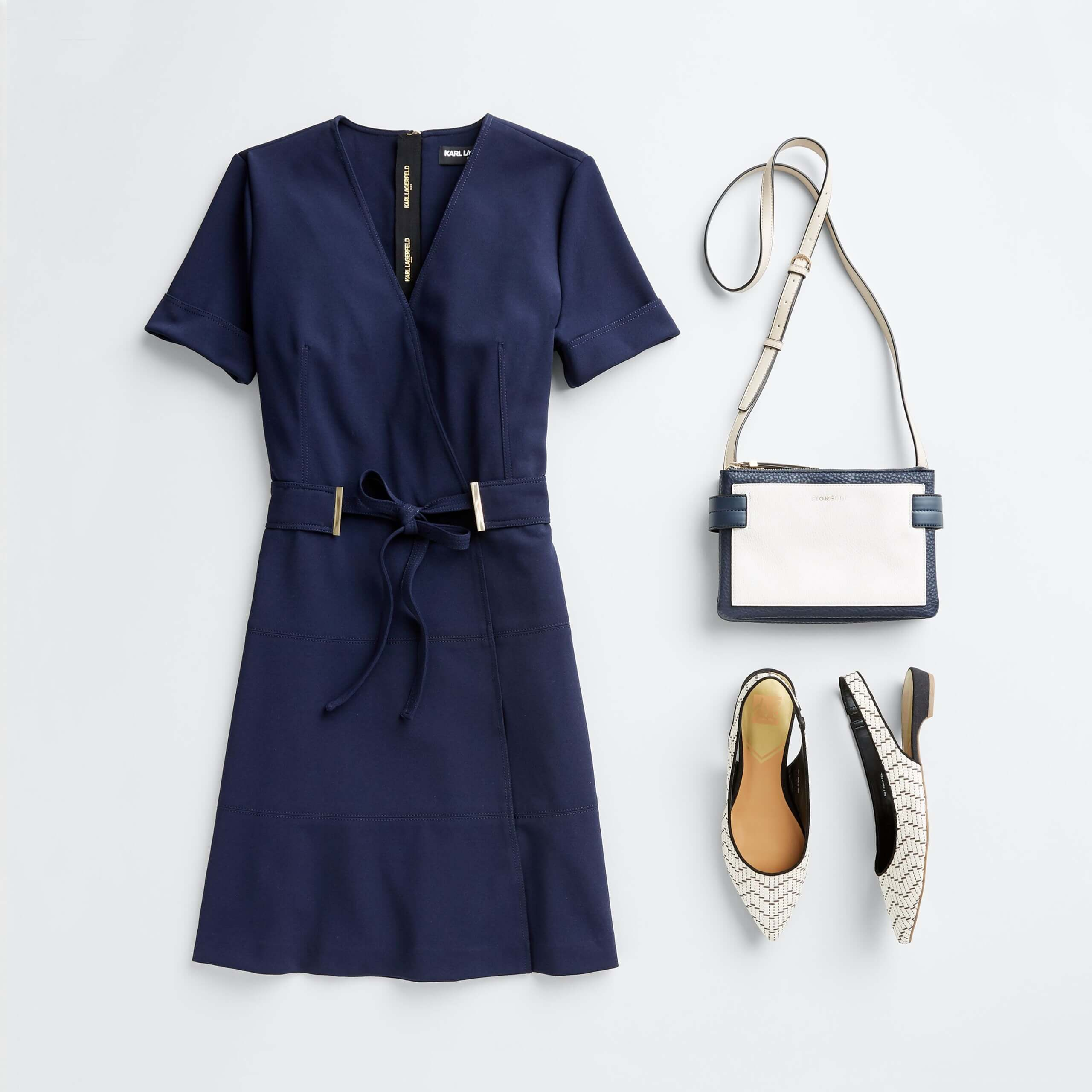 Stitch Fix Women's outfit laydown featuring navy tie-waist dress, white slingback flats and white crossbody purse.