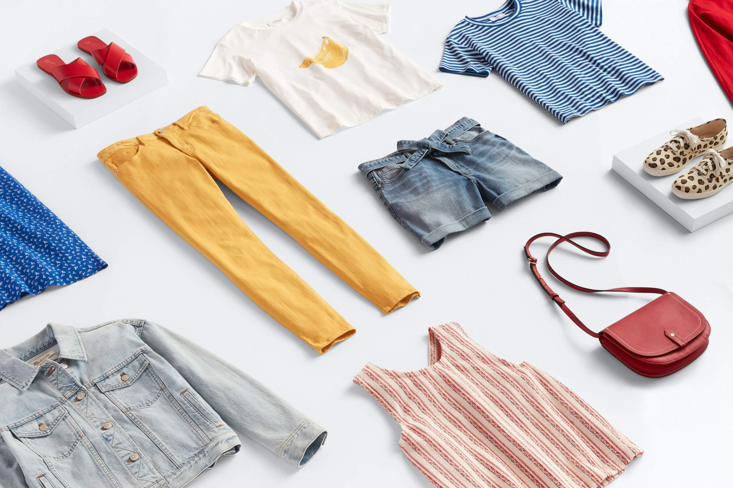 Stitch Fix women's outfit laydown featuring blue, red, yellow and white clothing and accessories.
