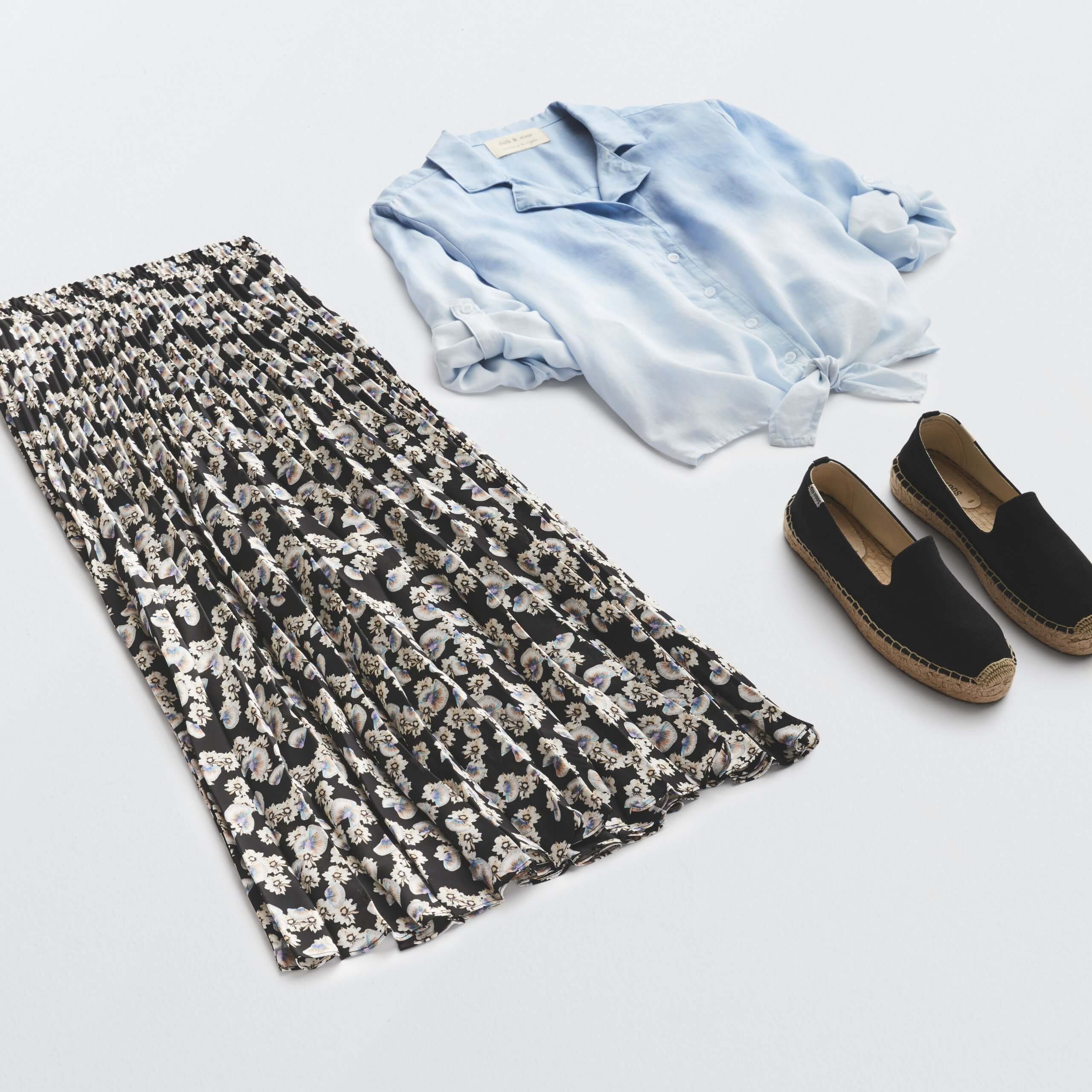 Stitch Fix Women's outfit laydown featuring floral pleated midi skirt, chambray button-front shirt and black espadrille flats.