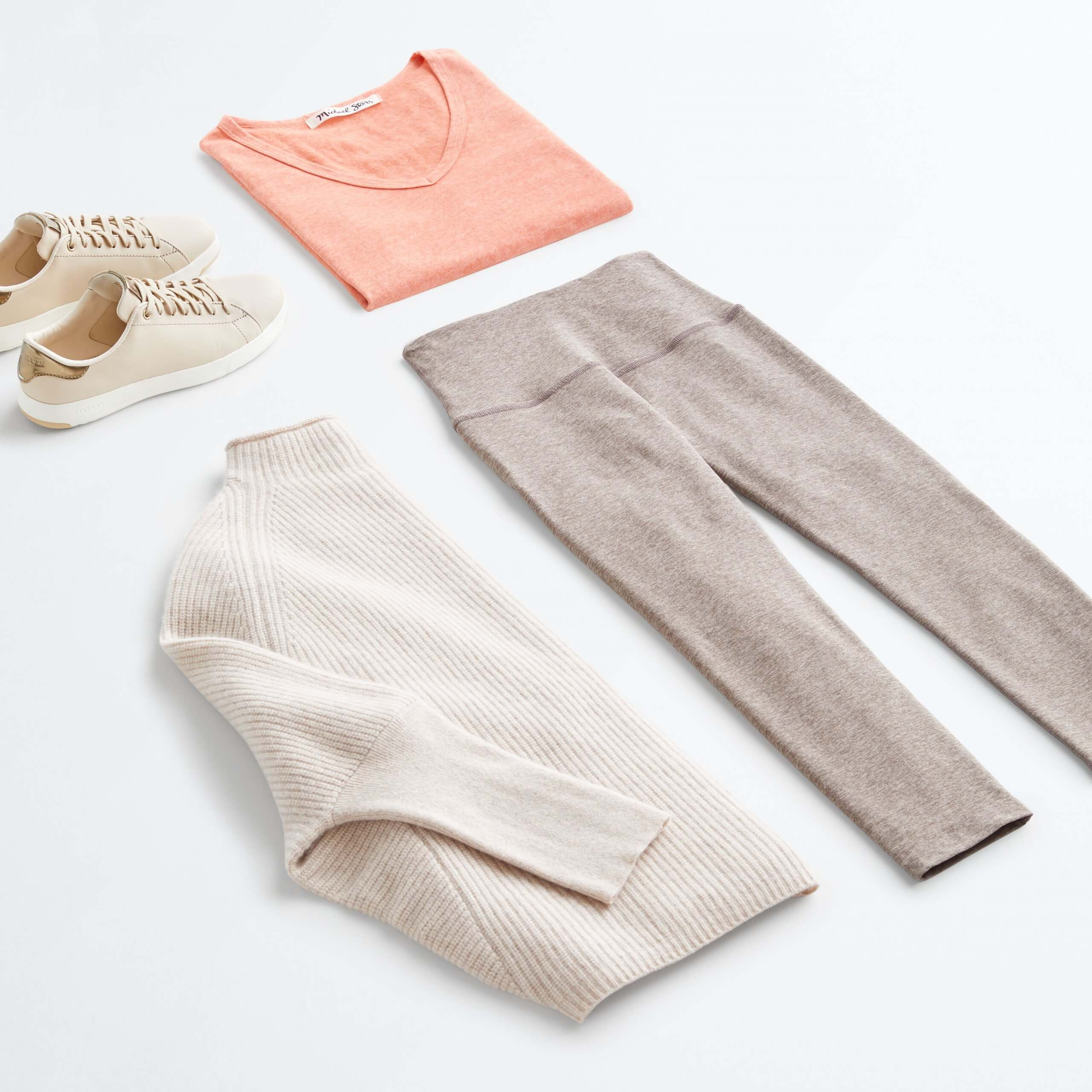 Stitch Fix Women's outfit laydown featuring beige leggings, cream pullover, pink t-shirt and tan sneakers.