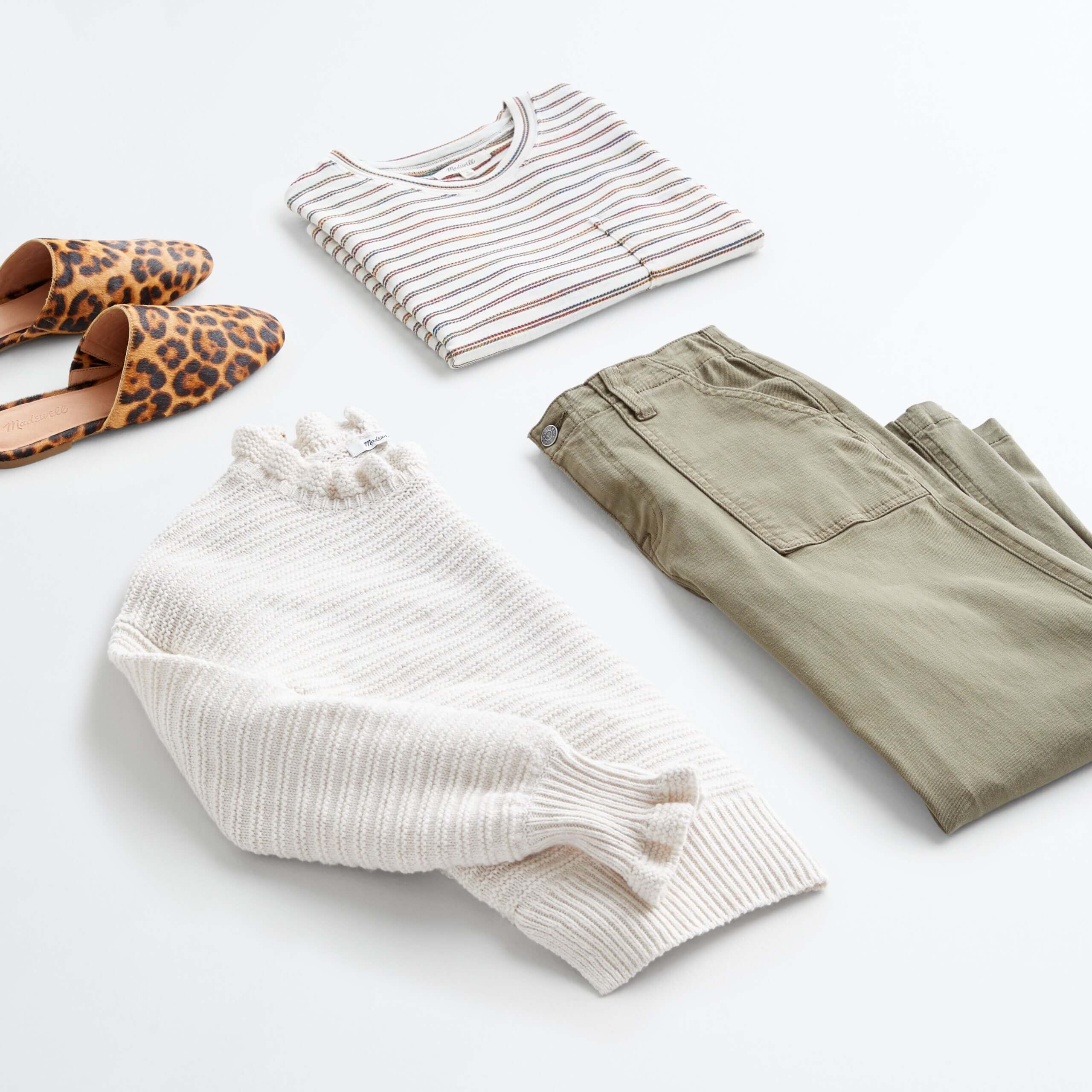 Stitch Fix Women's outfit laydown featuring olive utility pants, beige pullover sweater, striped tee and animal-print slide-on flats.