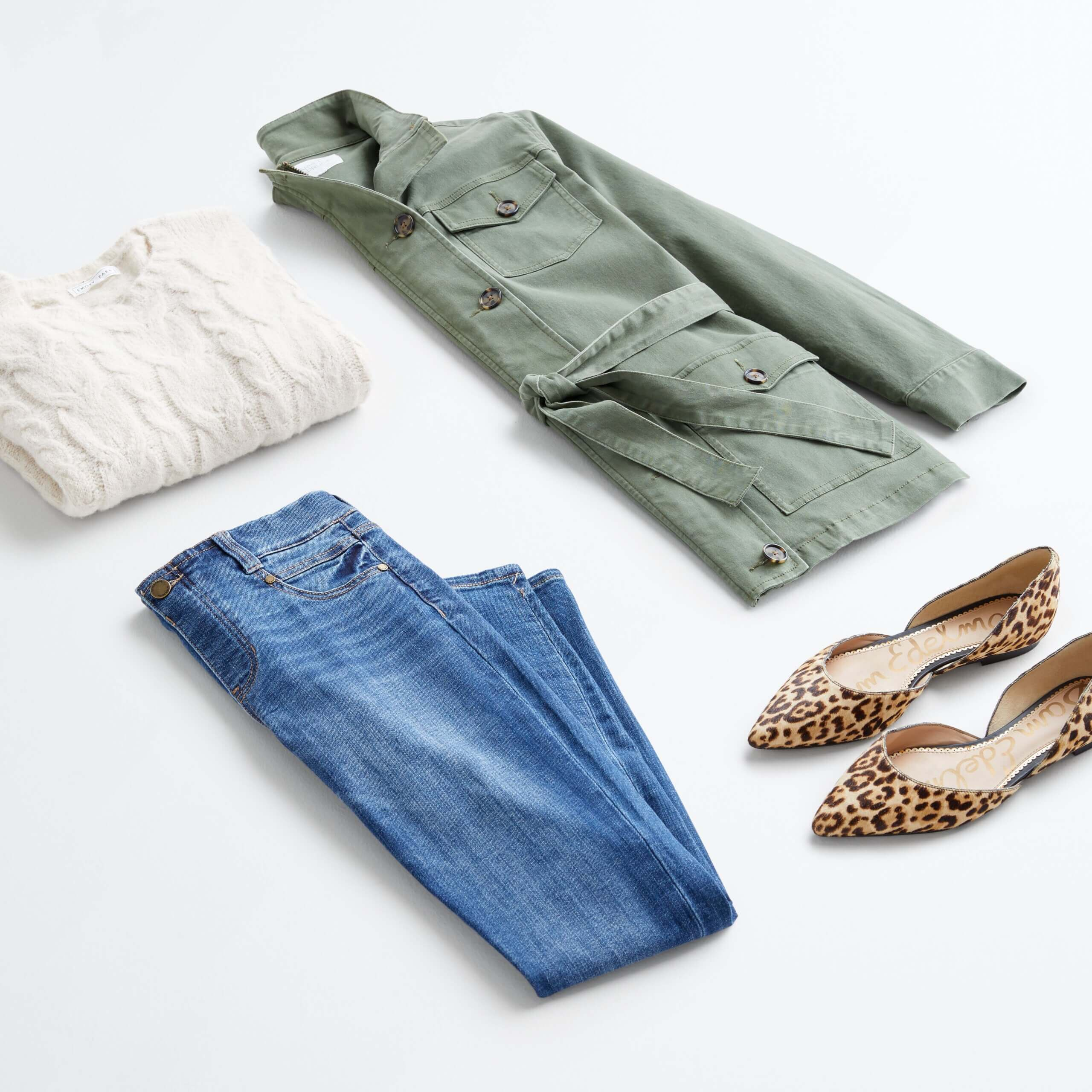 Stitch Fix Women's outfit laydown featuring cream cable knit pullover, green cargo jacket, blue jeans and cheetah print flats.