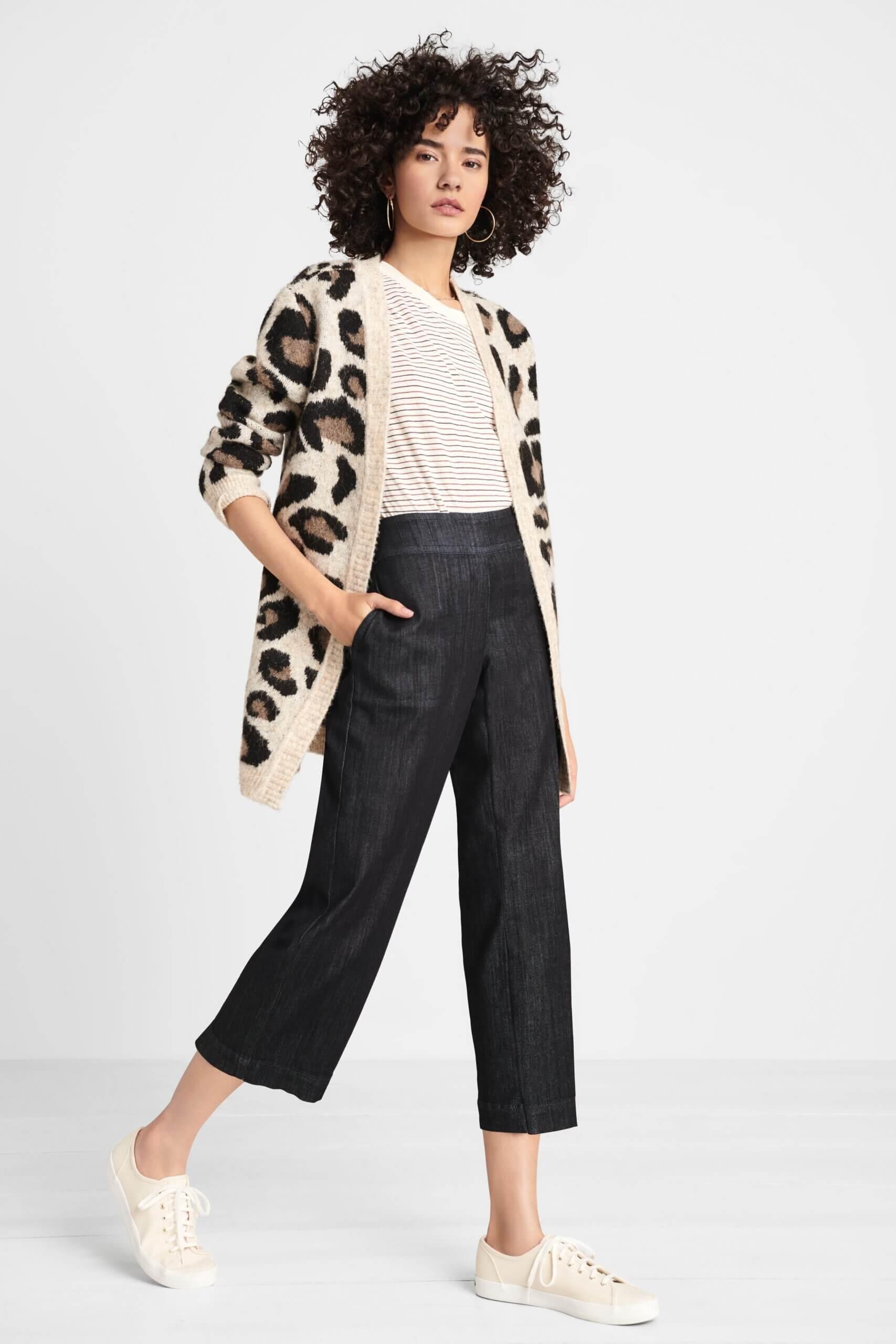 Stitch Fix women's model wearing black wide-leg cropped denim, cream striped tee, leopard print cardigan and white sneakers.
