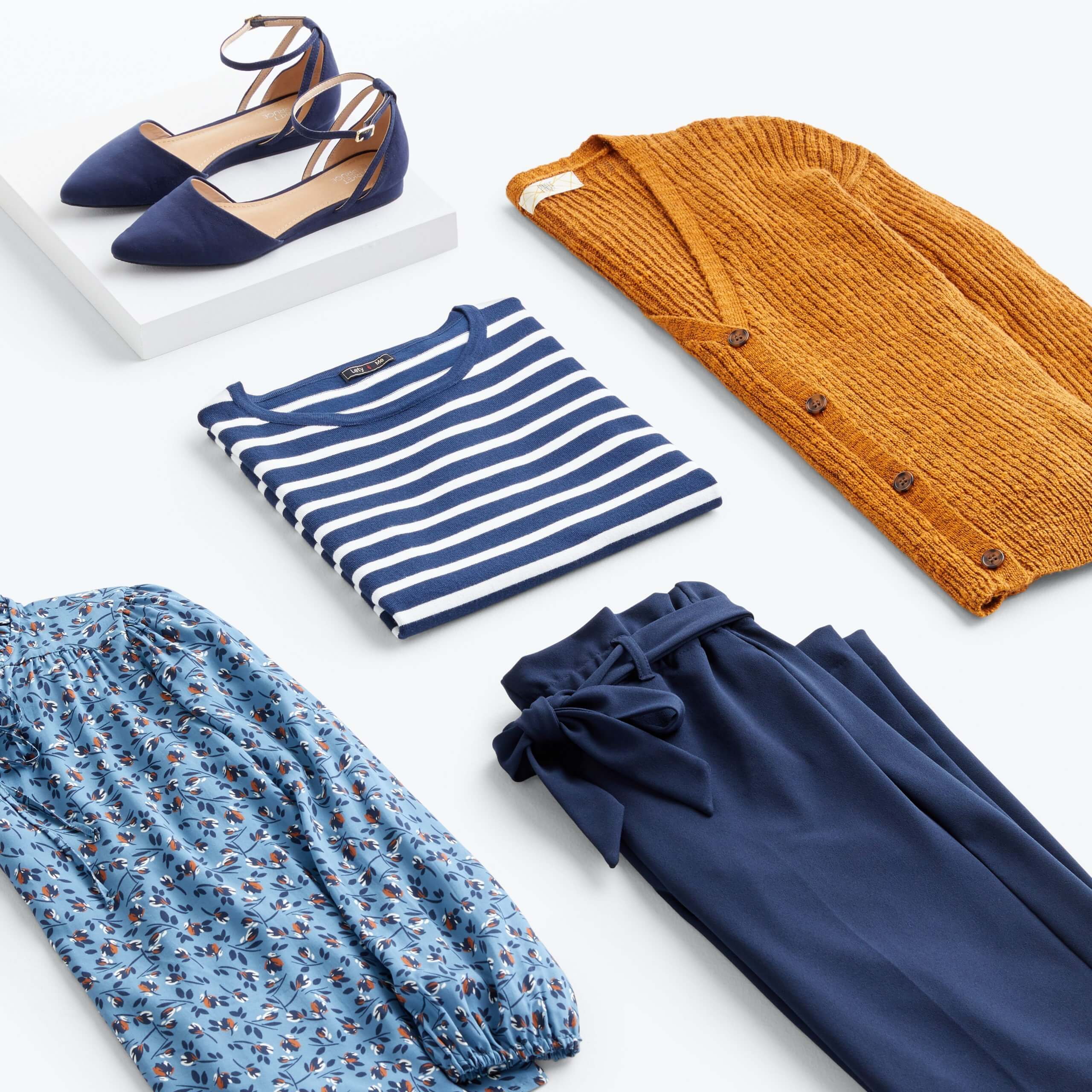 Stitch Fix women's fall 2021 outfit with blue and white striped T-shirt, mustard cardigan, blue floral blouse, navy pants and flats.