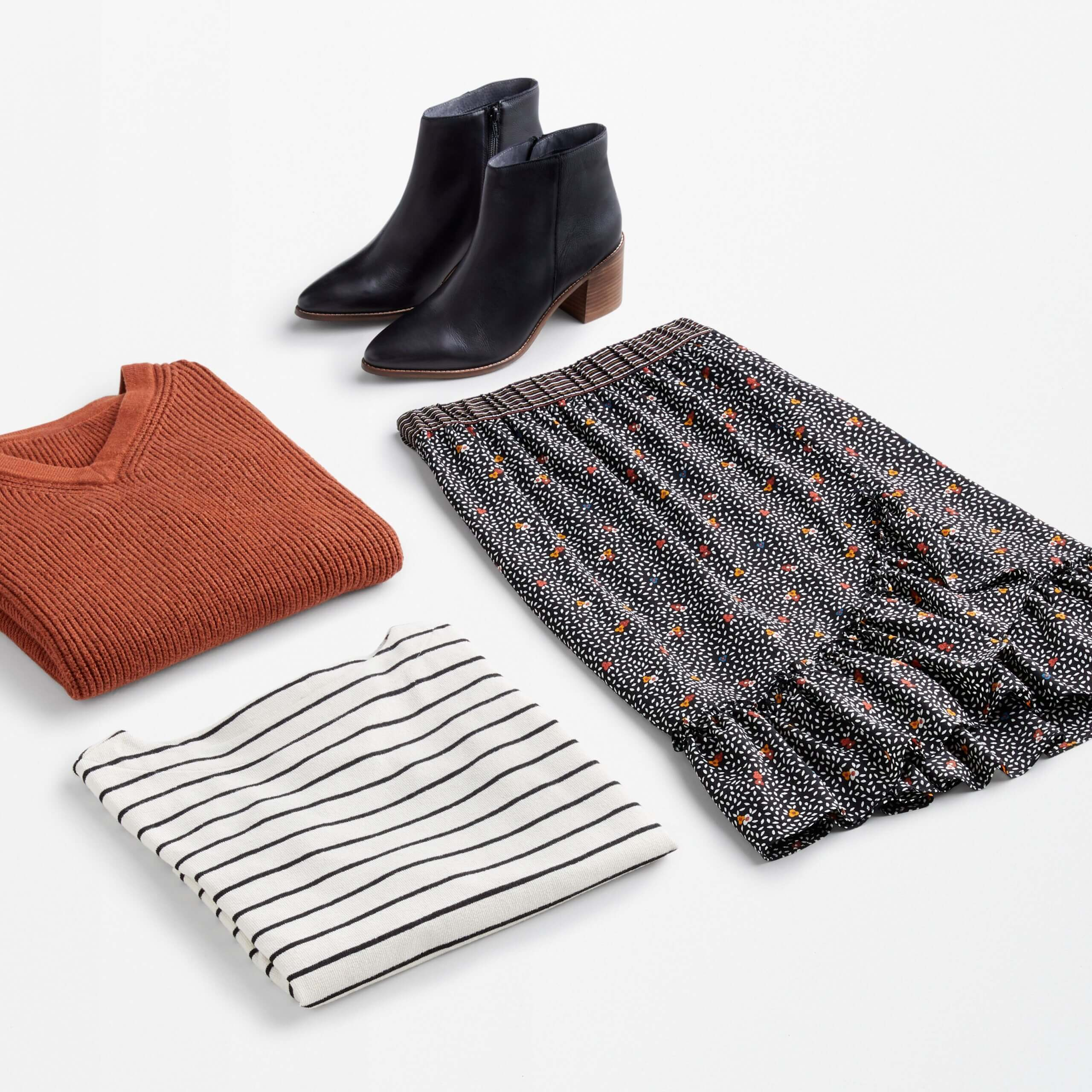 Stitch Fix Women's date night at home featuring floral midi skirt, striped tee, red v-neck sweater and black ankle boots.