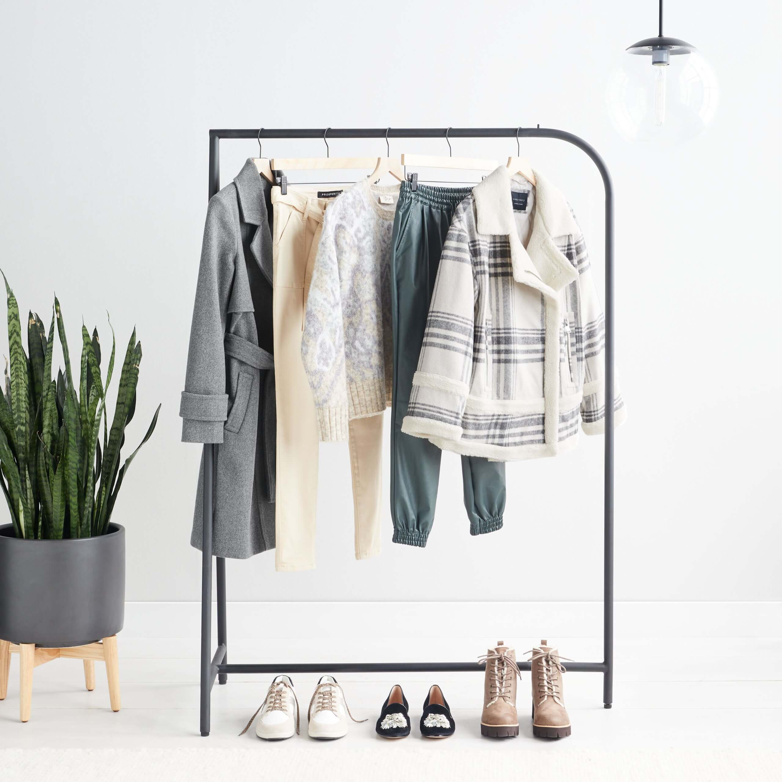 Stitch Fix Women's Collection featuring grey coat, yellow pants, animal-print cardigan, blue joggers, plaid coat and shoes.