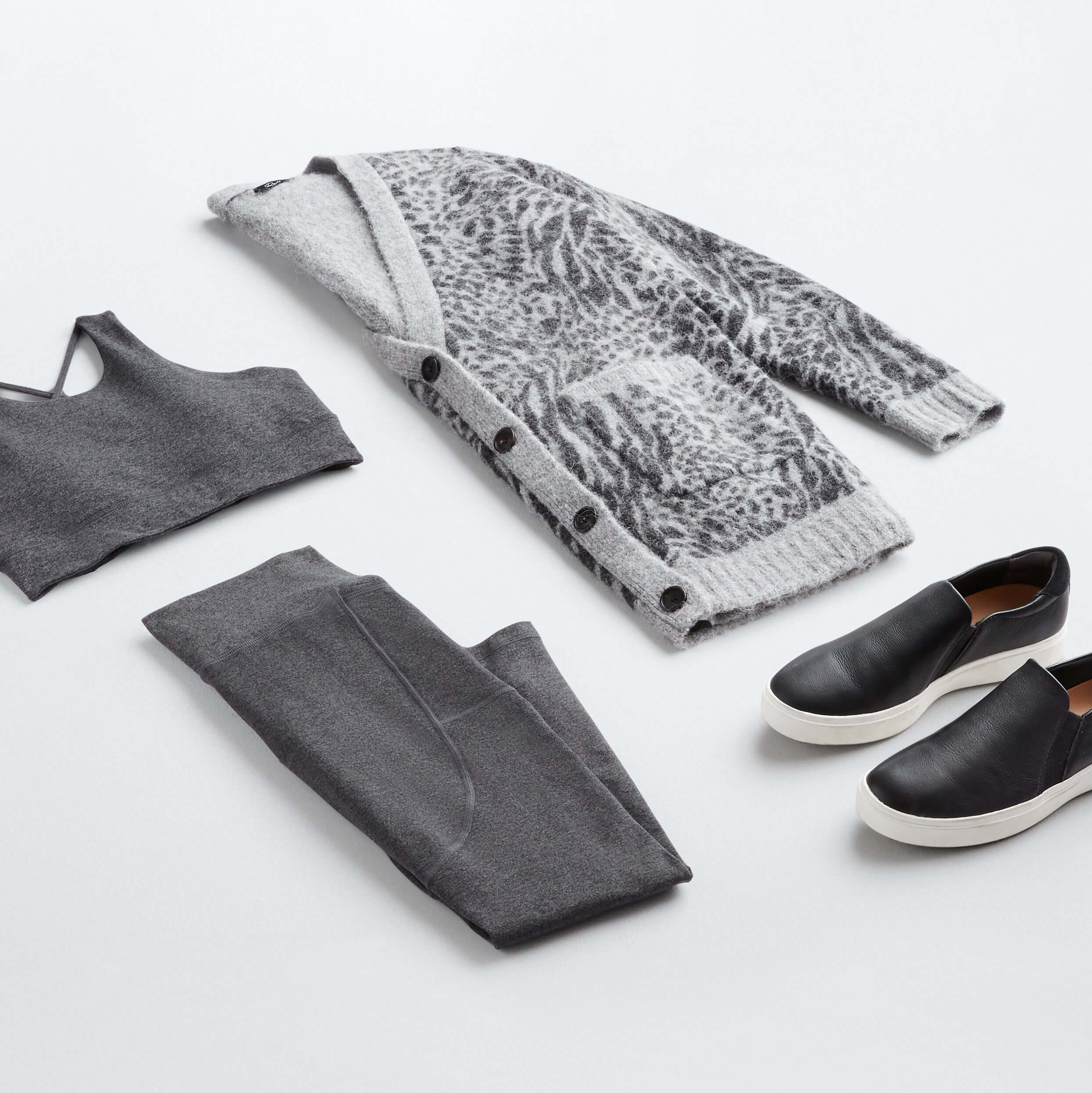 Stitch Fix outfit laydown featuring grey animal print cardigan, grey sports bra, grey leggings and black leather sneakers.